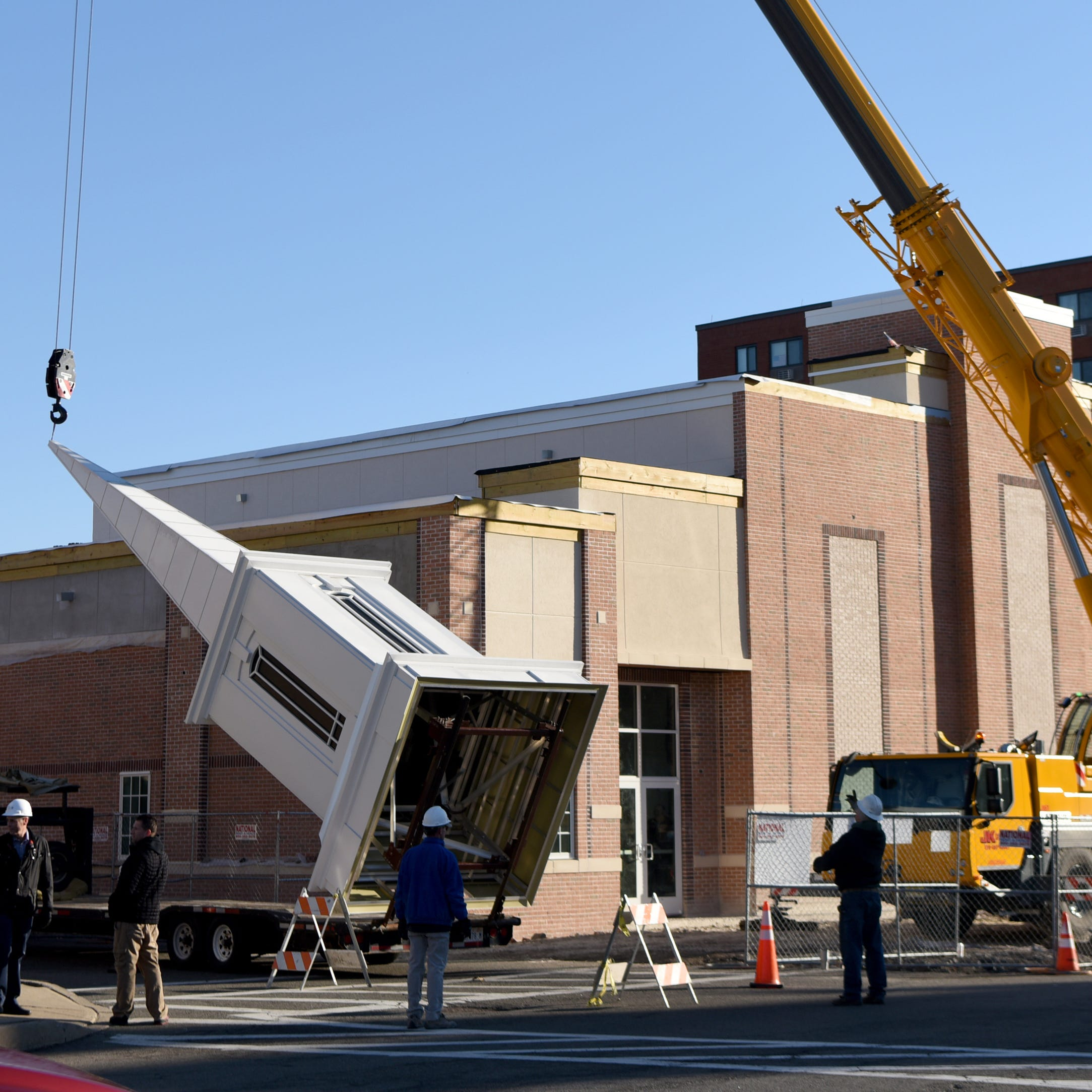 Crane tops new Dover church with 40-foot tall steeple