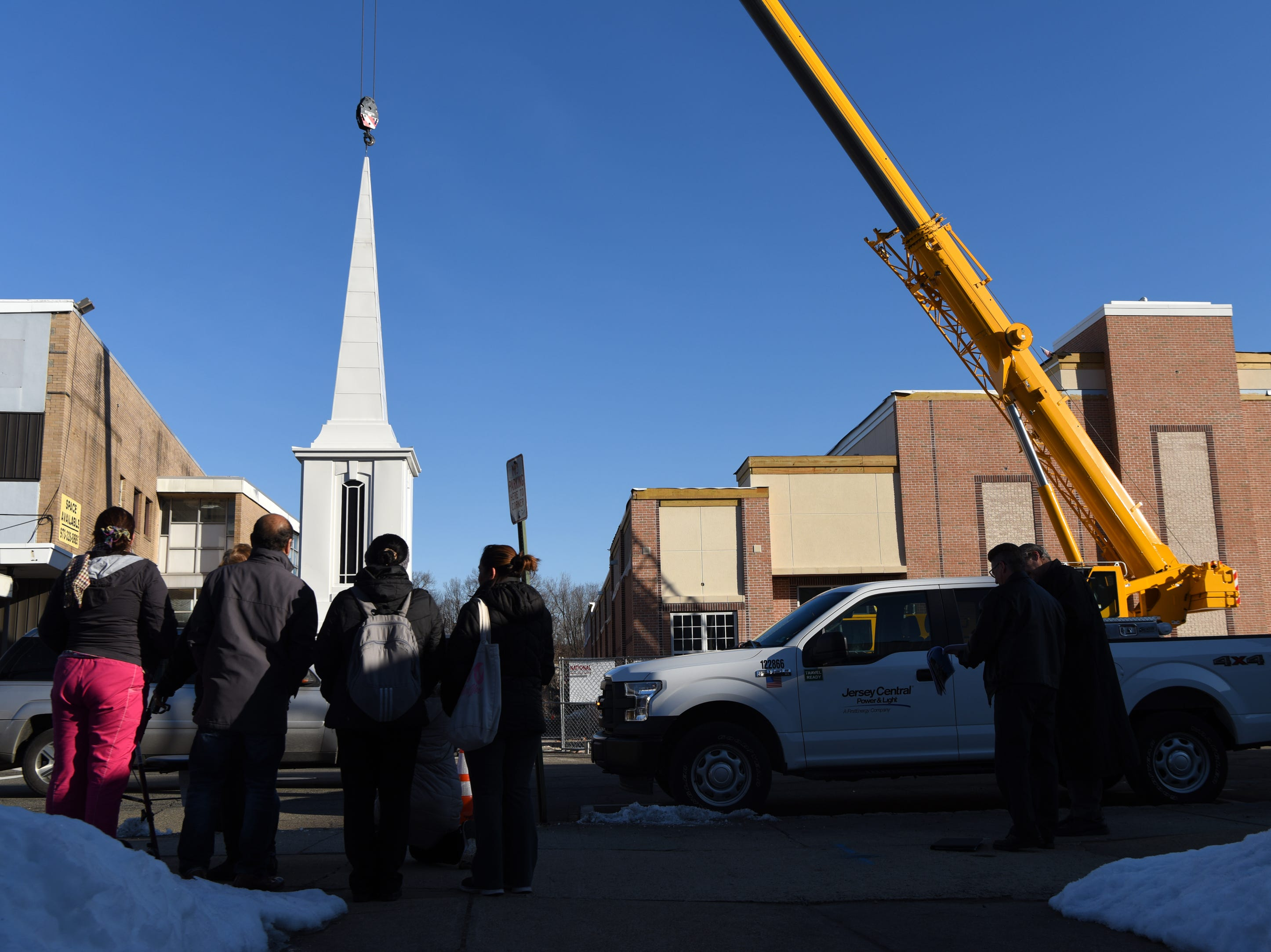 A crane is used to raise a steeple onto the The Church of Jesus Christ of Later-day Saints in Dover on Wednesday, March 13, 2019.