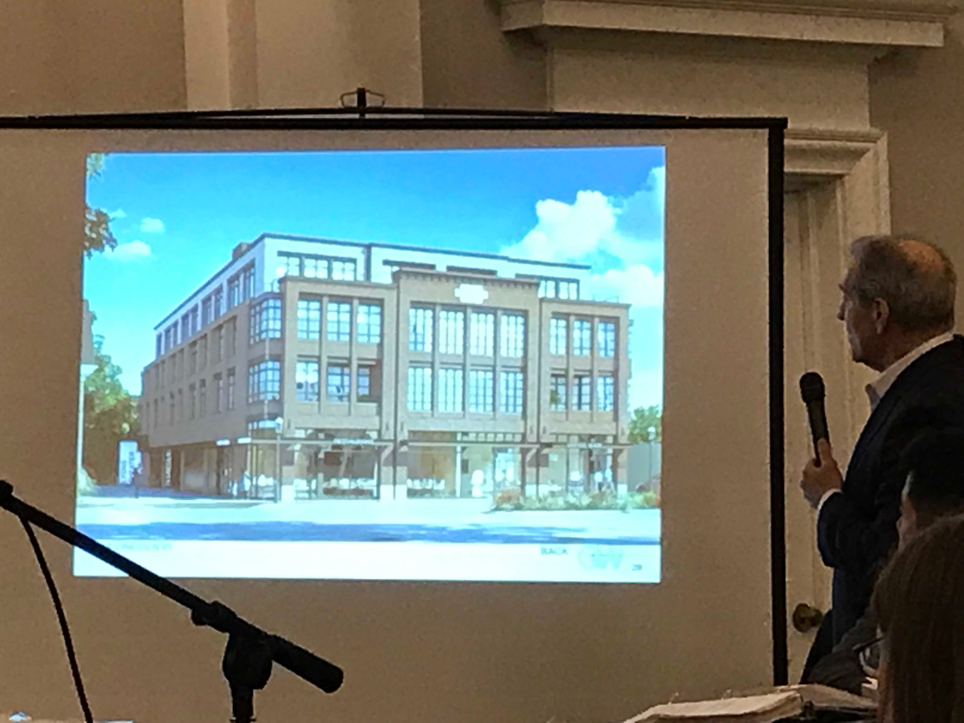 Architect Jeffrey Gertlier presents a rendering of a proposed retail-residential building that would replace the Madison Theatre at the Madison Historic Preservation Commission meeting March 12, 2019.