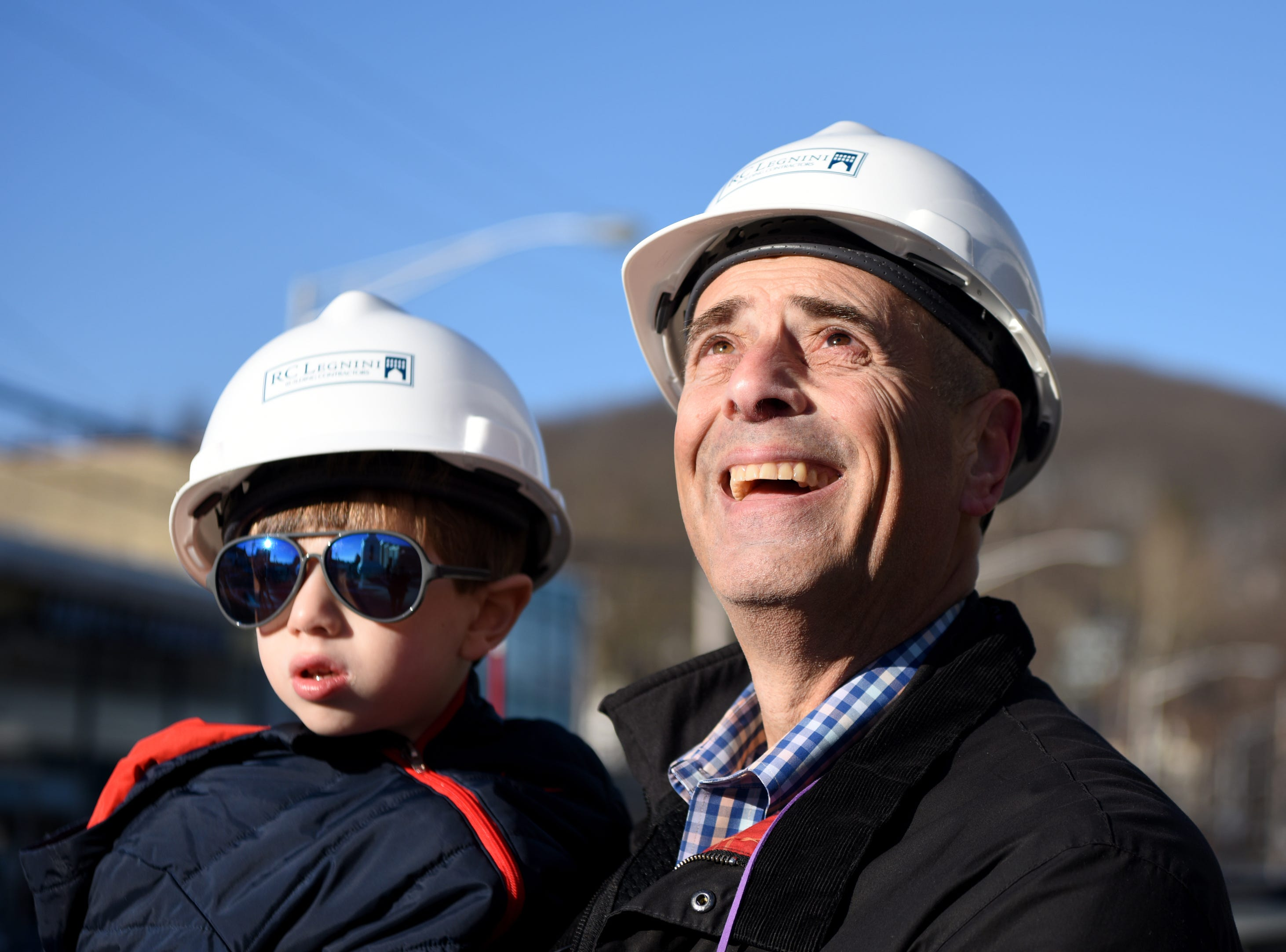 Builder Mitch Handman, and his grandson Aaron Zimmerman, 3, watch a crane raise a steeple onto the church in Dover on Wednesday, March 13, 2019.