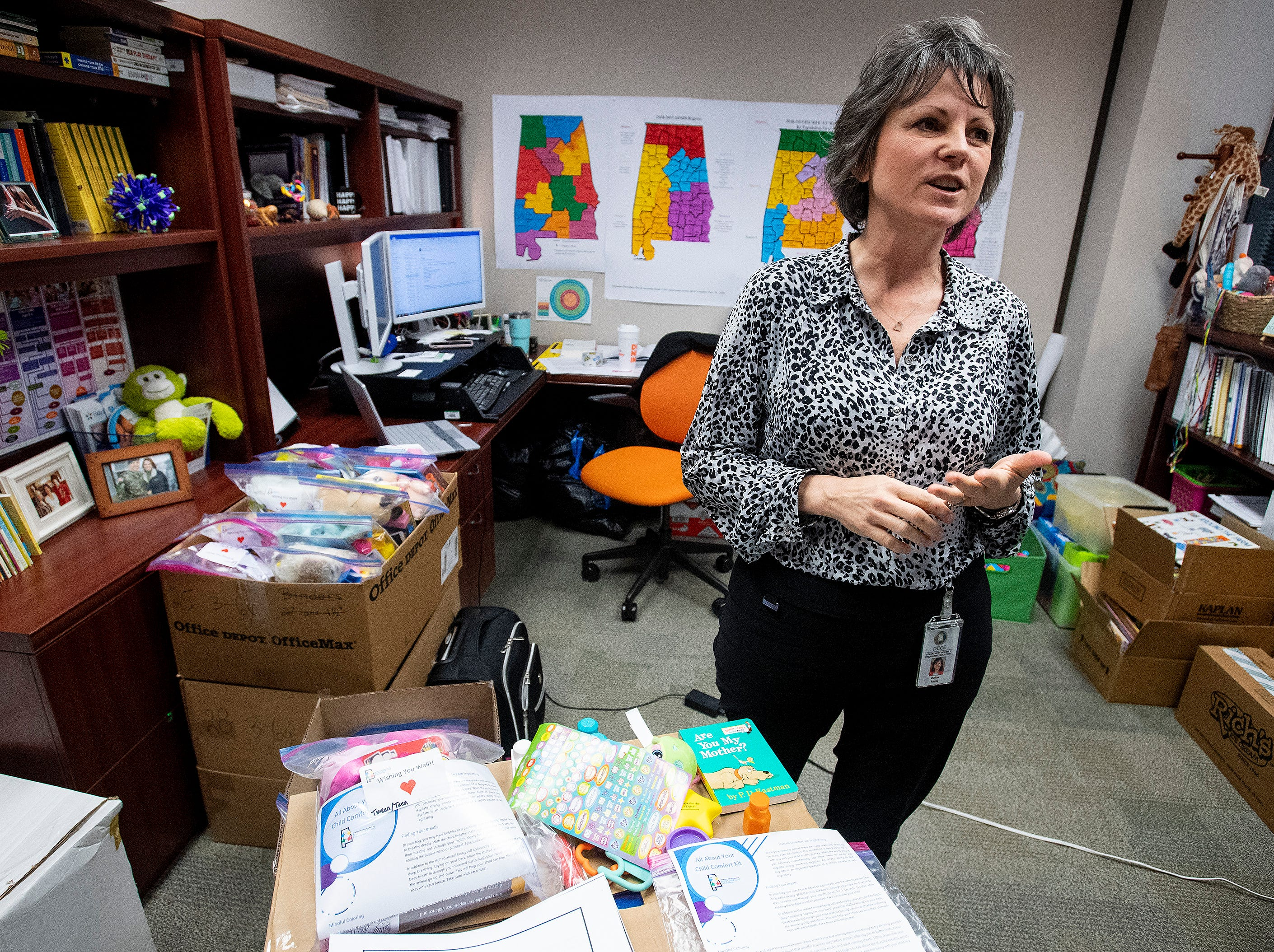 Dallas Rabig, of the Department of Early Childhood Education, discusses the child comfort kits being given to the Red Cross, on Wednesday March 13, 2019 in Montgomery, Ala., to be distributed to children in the wake of the Lee County tornados.