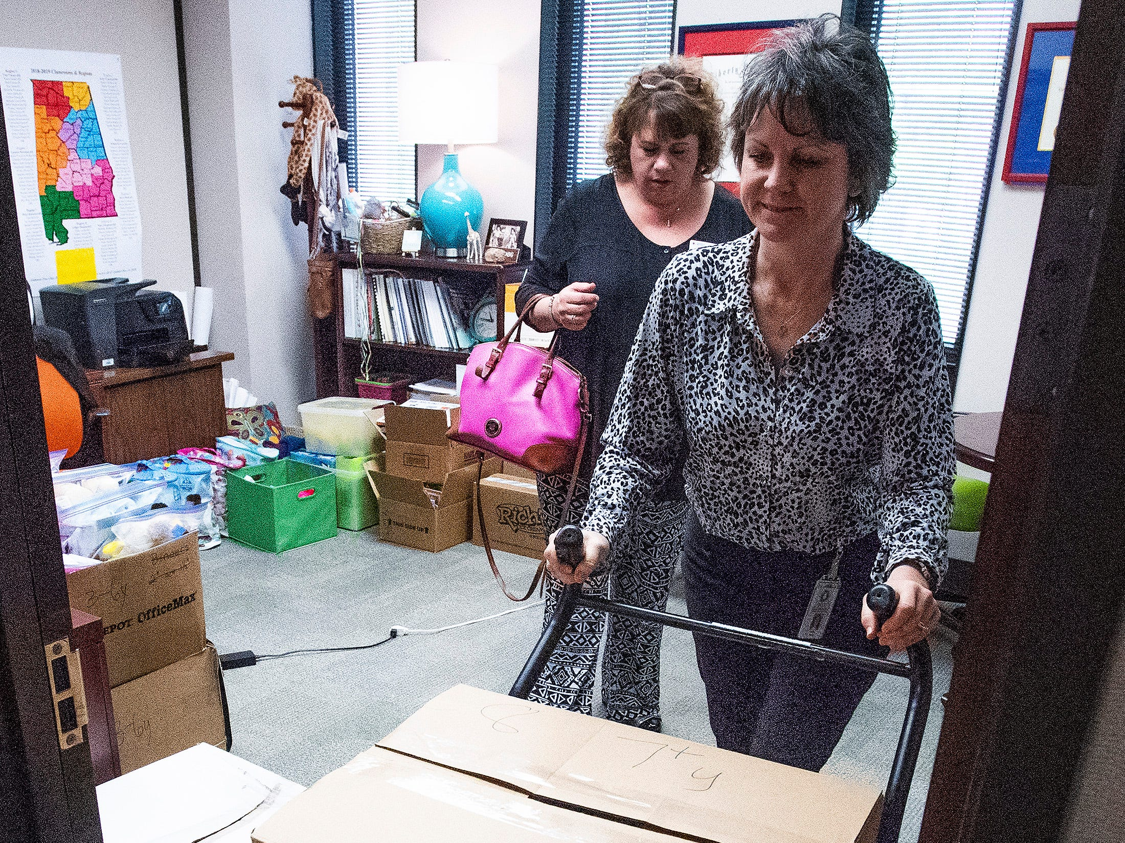 Dallas Rabig, of the Department of Early Childhood Education, right, gives child comfort kits to Kelly Hodges, of the Red Cross, on Wednesday March 13, 2019 in Montgomery, Ala., to be distributed to children in the wake of the Lee County tornados.