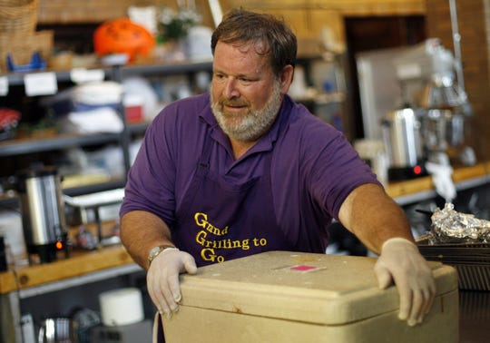 Ron Orebaugh of Grand Grilling to Go cleans up following a dinner he catered at Cornerstone Center for the Arts in this file photo.