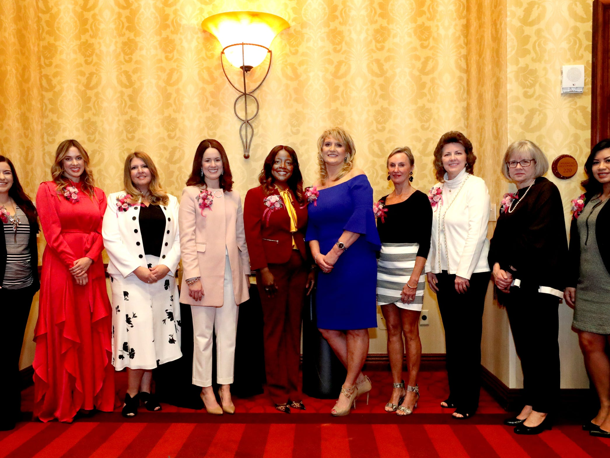 Ten women were recognized by Murfreesboro Magazine during the 2019 Women in Business Luncheon on Tuesday, March 12, 2019, at the Embassy Suites Murfreesboro. (L to R) Rebecca Goodwin, Co-owner and Office Manager of Goodwin Plumbing, Elizabeth Allen, owner of e.Allen boutiques, Ladawna Parham, Executive Director at Nourish Food Bank, Megan Bynum, certified Financial Planner, Novonda Lilly, Director of Talent Temp/Force and Executive Search at Vanderbilt University Medical Center, Sheri Morgan, owner of Tri Star Title and Escrow, Dr. Elizabeth Laroche, M.D. at Mid-TN-GYN and Owner of Body and Face, Melissa Blair Wrigh, City Recorder, Treasure and Finance Director of the City of Murfreesboro, Debra Sells, Vice President for Student Affairs and Vice Provost for Enrollment Services at MTSU and Amy Jennings, owner of The Nail Room at Beehive Salon.