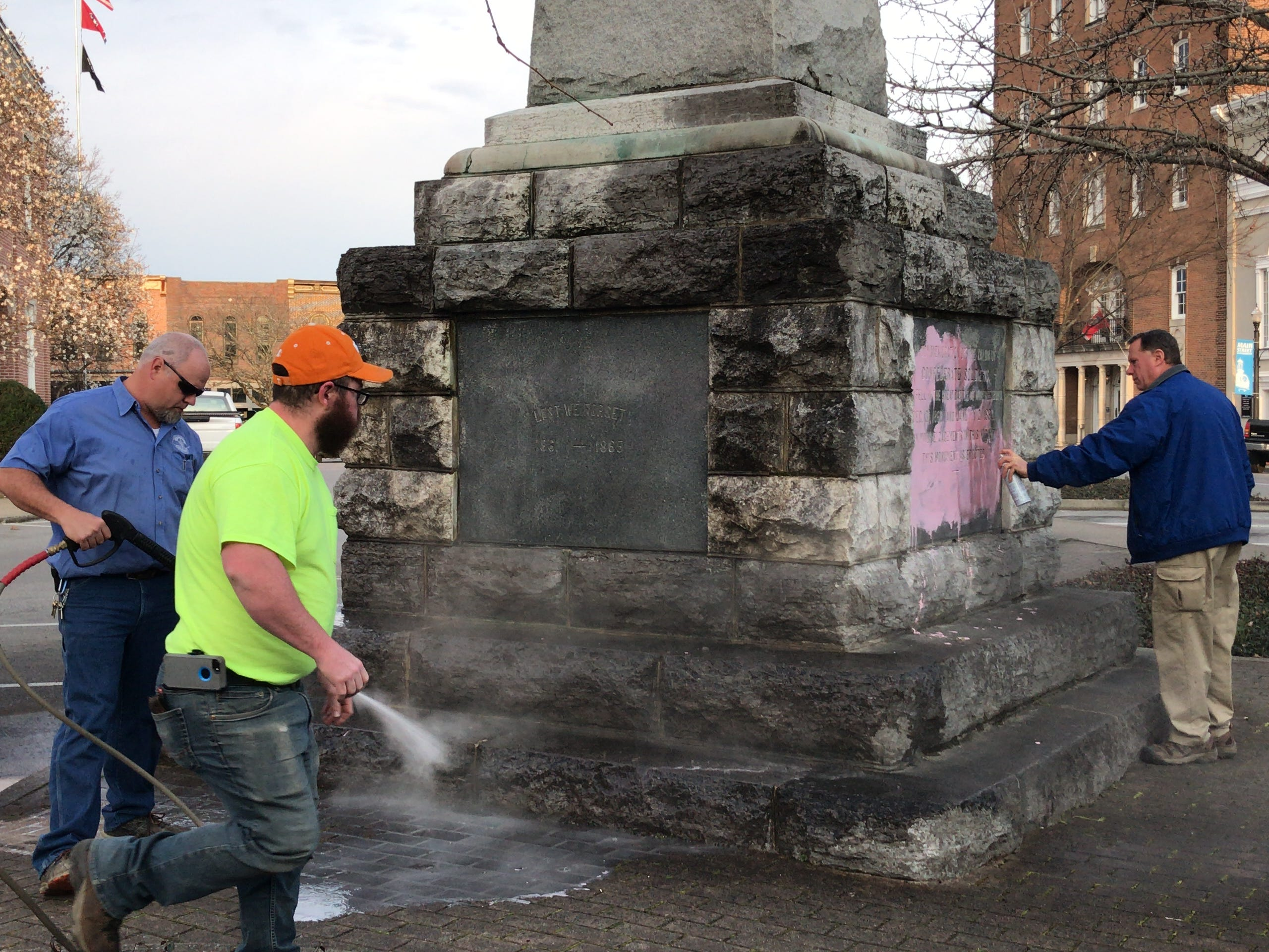 Rutherford County government workers pressure wash a Confederate statue on the Murfreesboro Public Square early Wednesday, March 13, 2019. The statue was vandalized with pint paint.