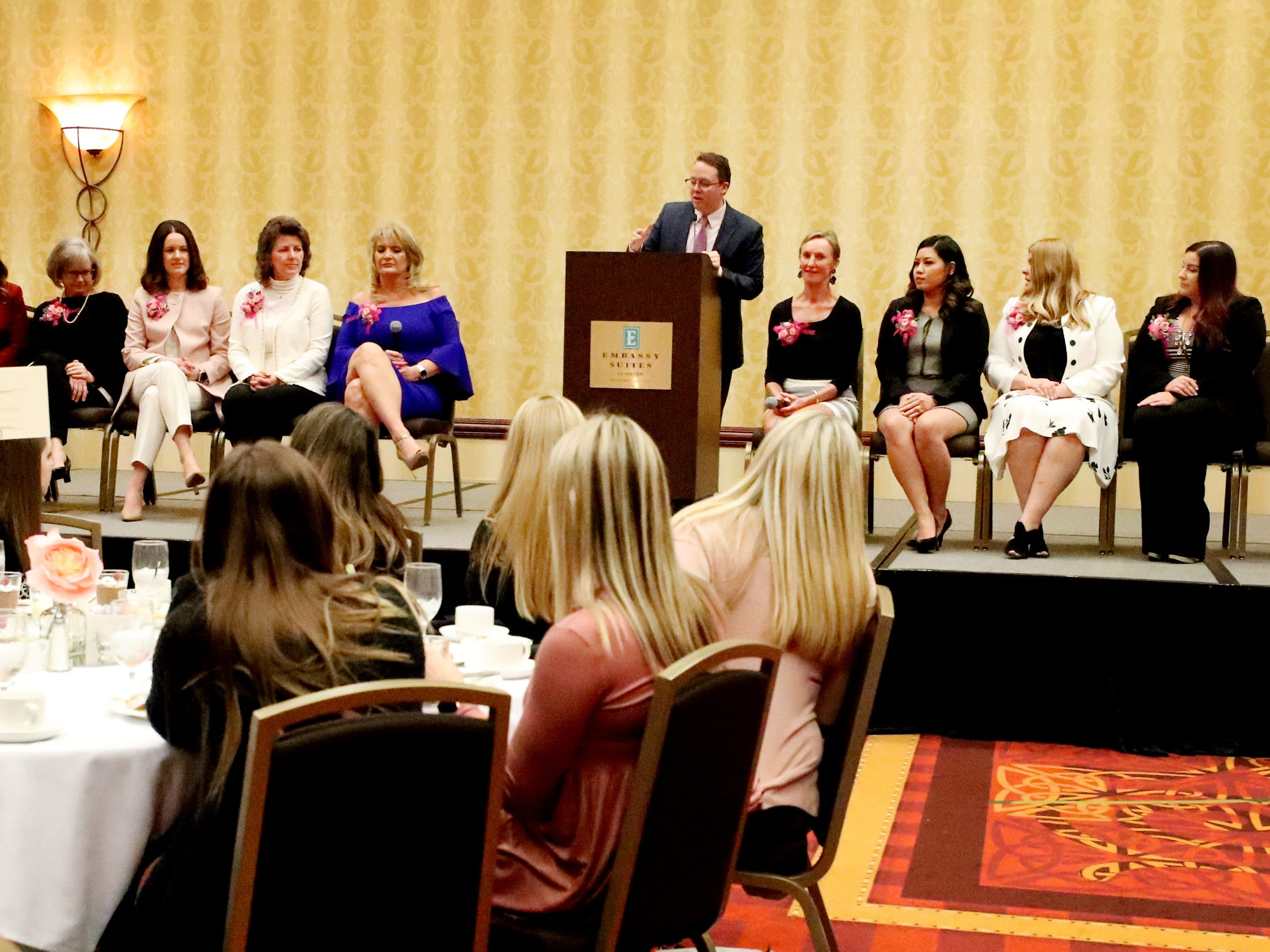 Brian Barry, Publisher of the Nashville Lifestyles and Murfreesboro Magazine, mc's Murfreesboro Magazine's 2019 Women in Business Luncheon on Tuesday, March 12, 2019, at the Embassy Suites Murfreesboro, and asks questions of the 9 other women honored during the event.