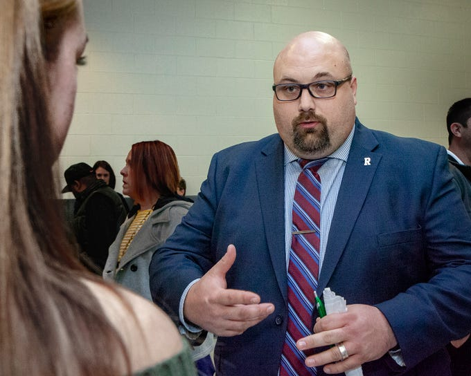 Rockvale High School Assistant Principal Jason Crutchfield talks with a student at the open house March 7, 2019.