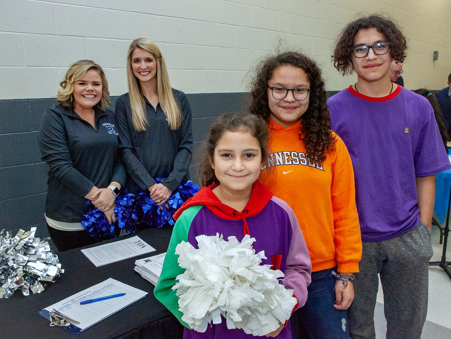 Seen at the Rockvale High School open house March 7, 2019. Alinda, Adela and Jared Garcia met with cheer coaches and teachers Dana Par, left, and Amber Greene.