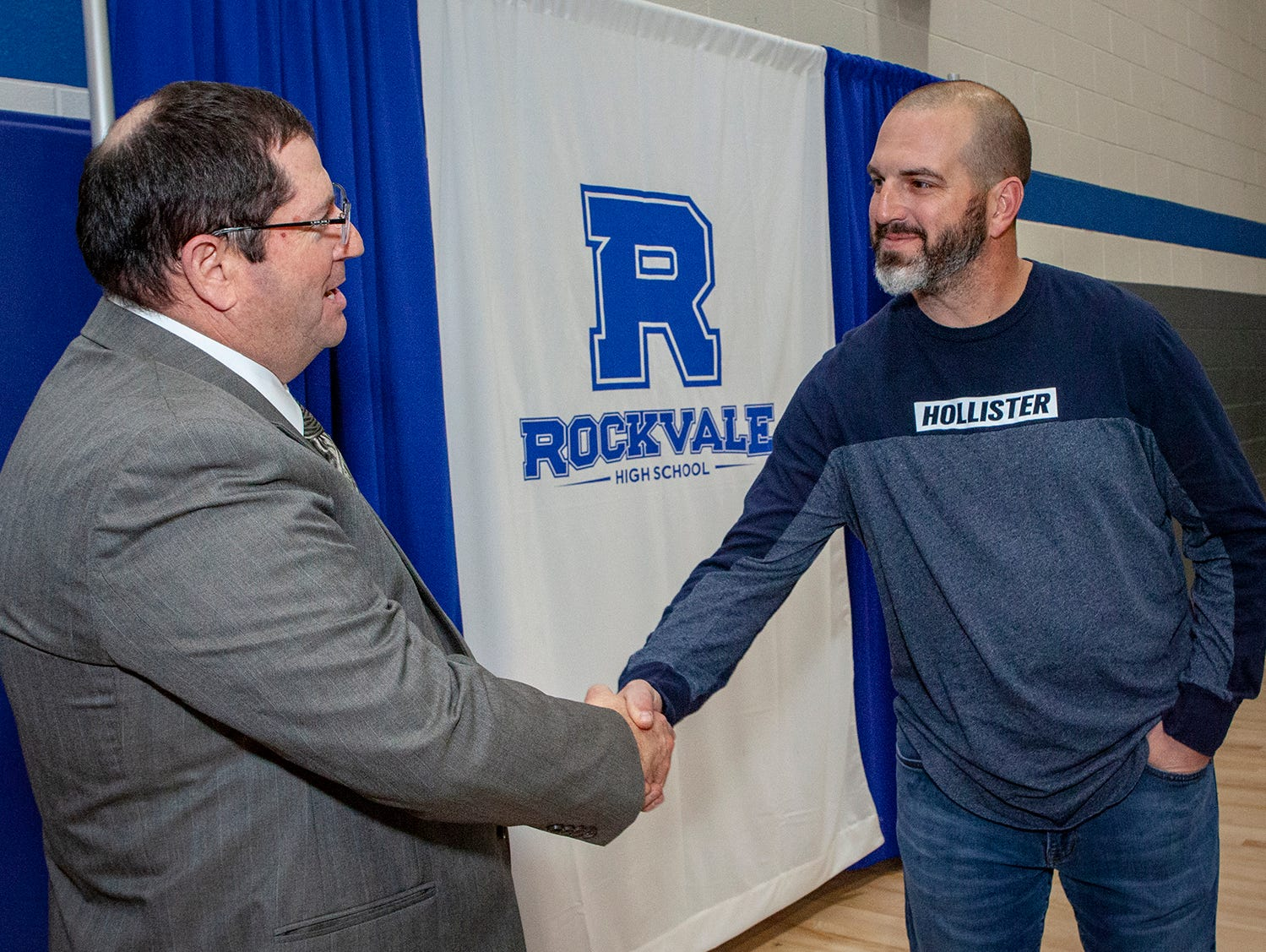 Rockvale High School principal Steve Luker greets at parent at the open house on March 7, 2019, at Rockvale Middle.