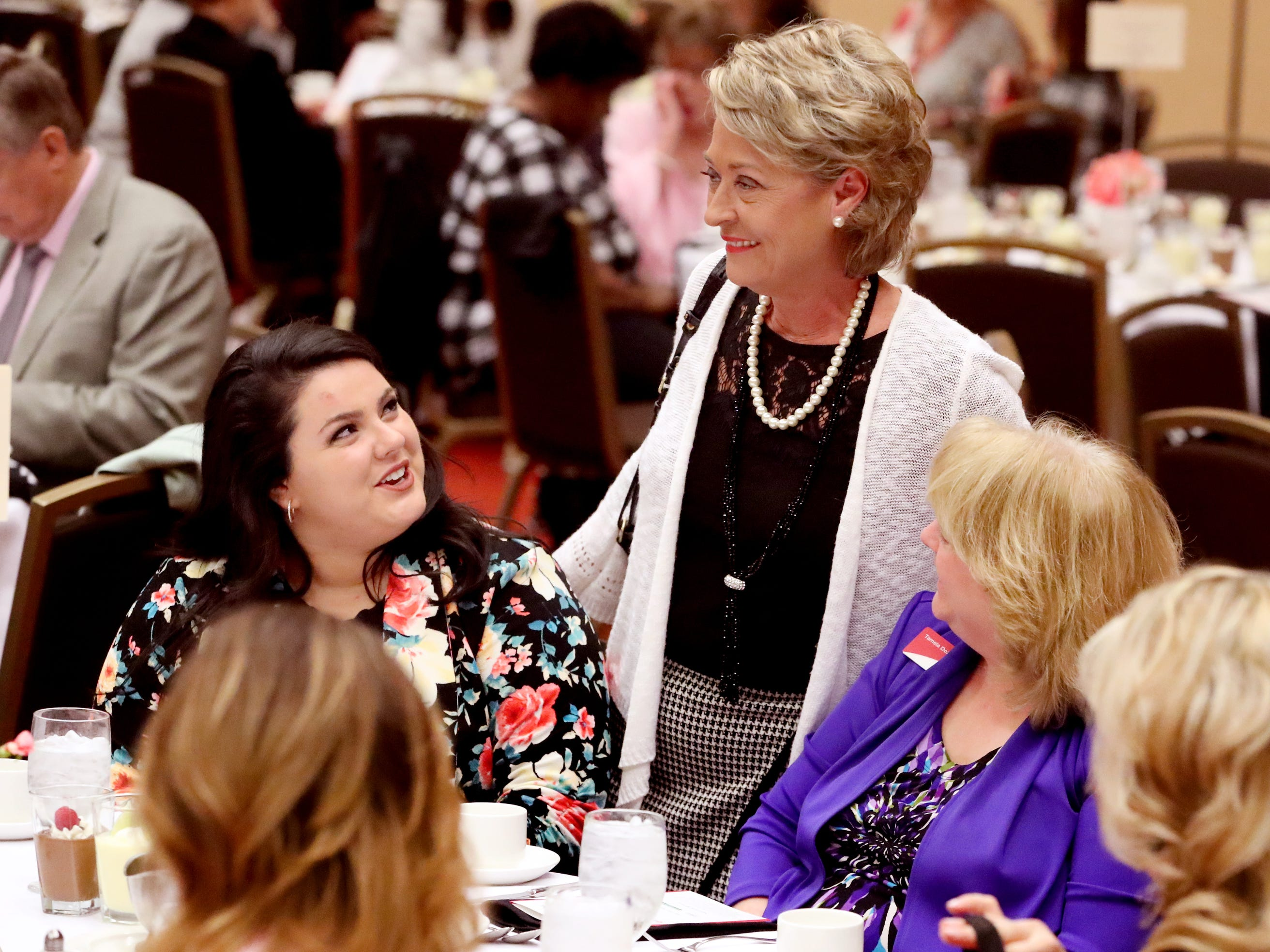 Natalie Hughes, center, talks with Carley McNeal, left, and Tamela Dozier, right at Murfreesboro Magazine's 2019 Women in Business Luncheon on Tuesday, March 12, 2019, at the Embassy Suites Murfreesboro.