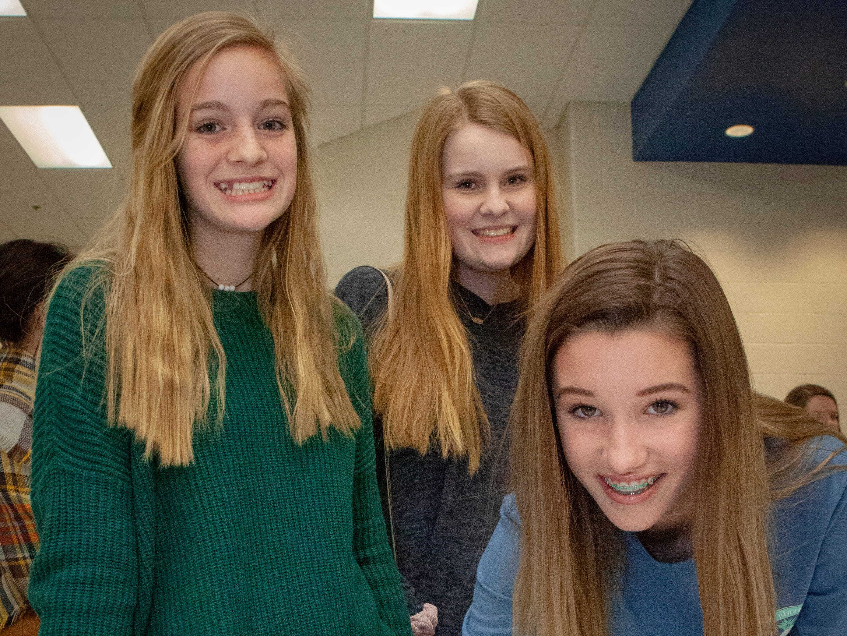 Incoming freshmen, from left, Chloe Morrison, Lydia Morrison and Taylor sign up for the soccer team at the Rockvale High School open house March 7, 2019.