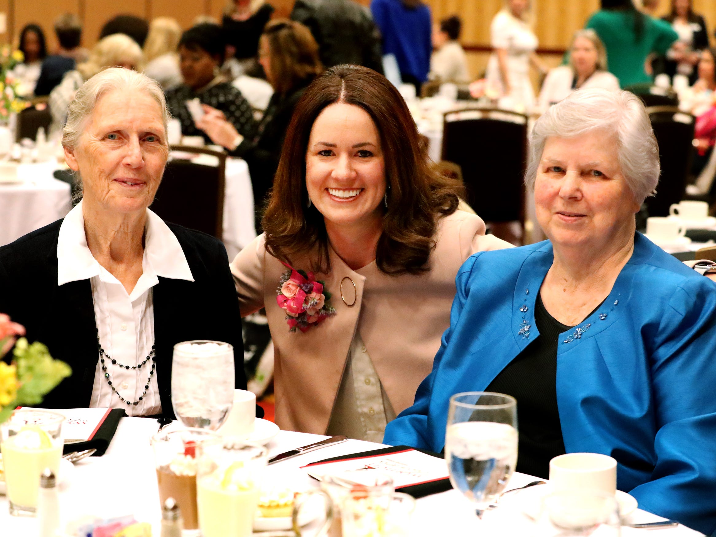 Megan Bynum, certified Financial Planner , center between her grandmother's Clara Jacobs, left and Reba Sanders, right, at Murfreesboro Magazine's 2019 Women in Business Luncheon on Tuesday, March 12, 2019, at the Embassy Suites Murfreesboro.