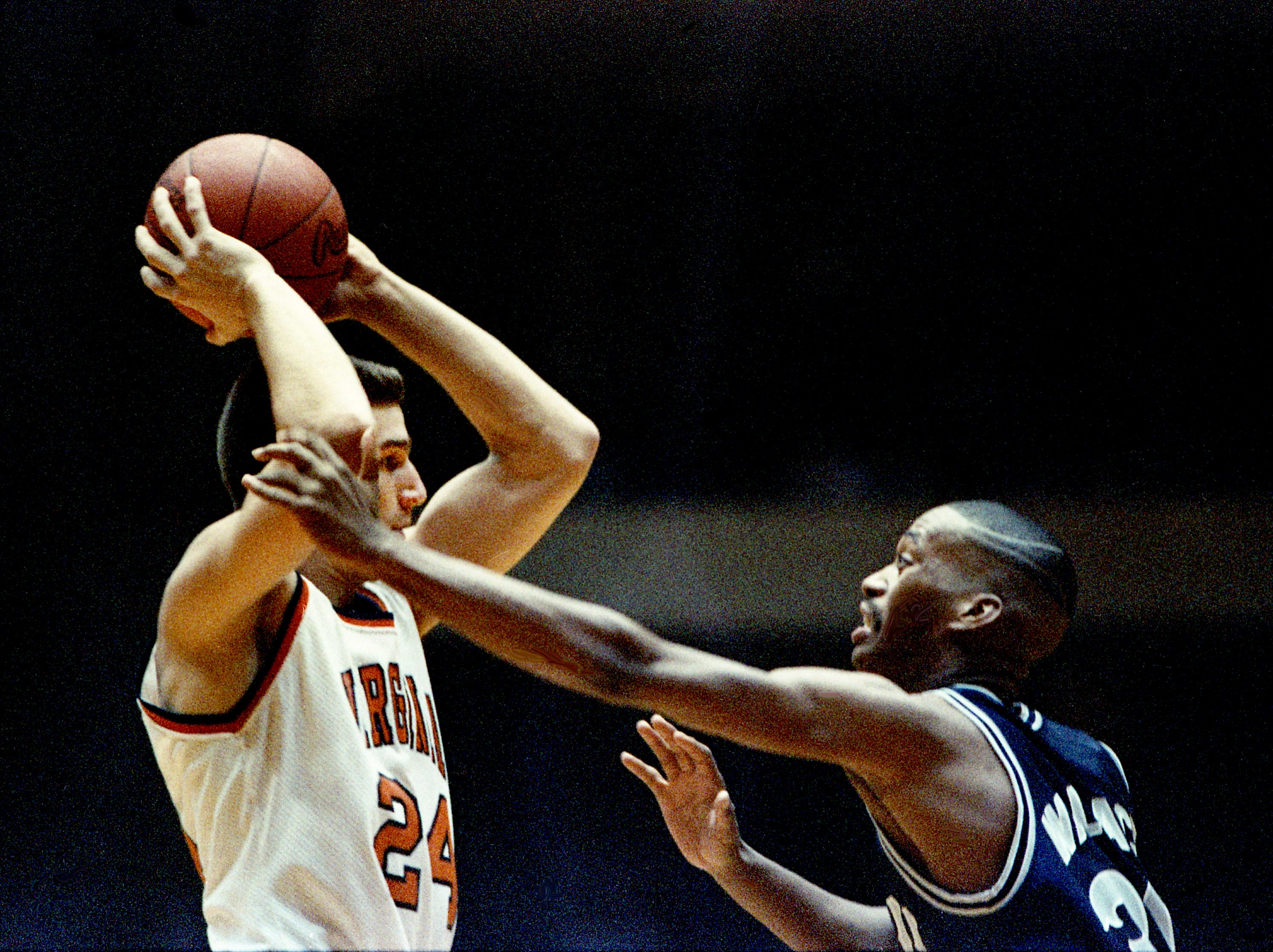 Middle Tennessee State's Kevin Wallace, right, puts the defense pressure on Dirk Katstra of Virginia, but it wasn't enough as the Blue Raiders fall 104-88 in the second round of the NCAA Southeast Regional before a crowd of 13,543 at Vanderbilt's Memorial Gym on March 18, 1989.