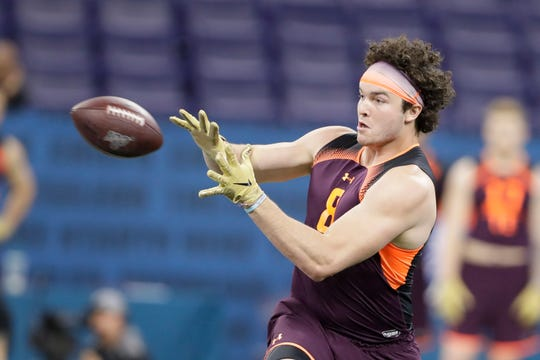Mississippi tight end Dawson Knox runs a drill during the NFL football scouting combine, Saturday, March 2, 2019, in Indianapolis.