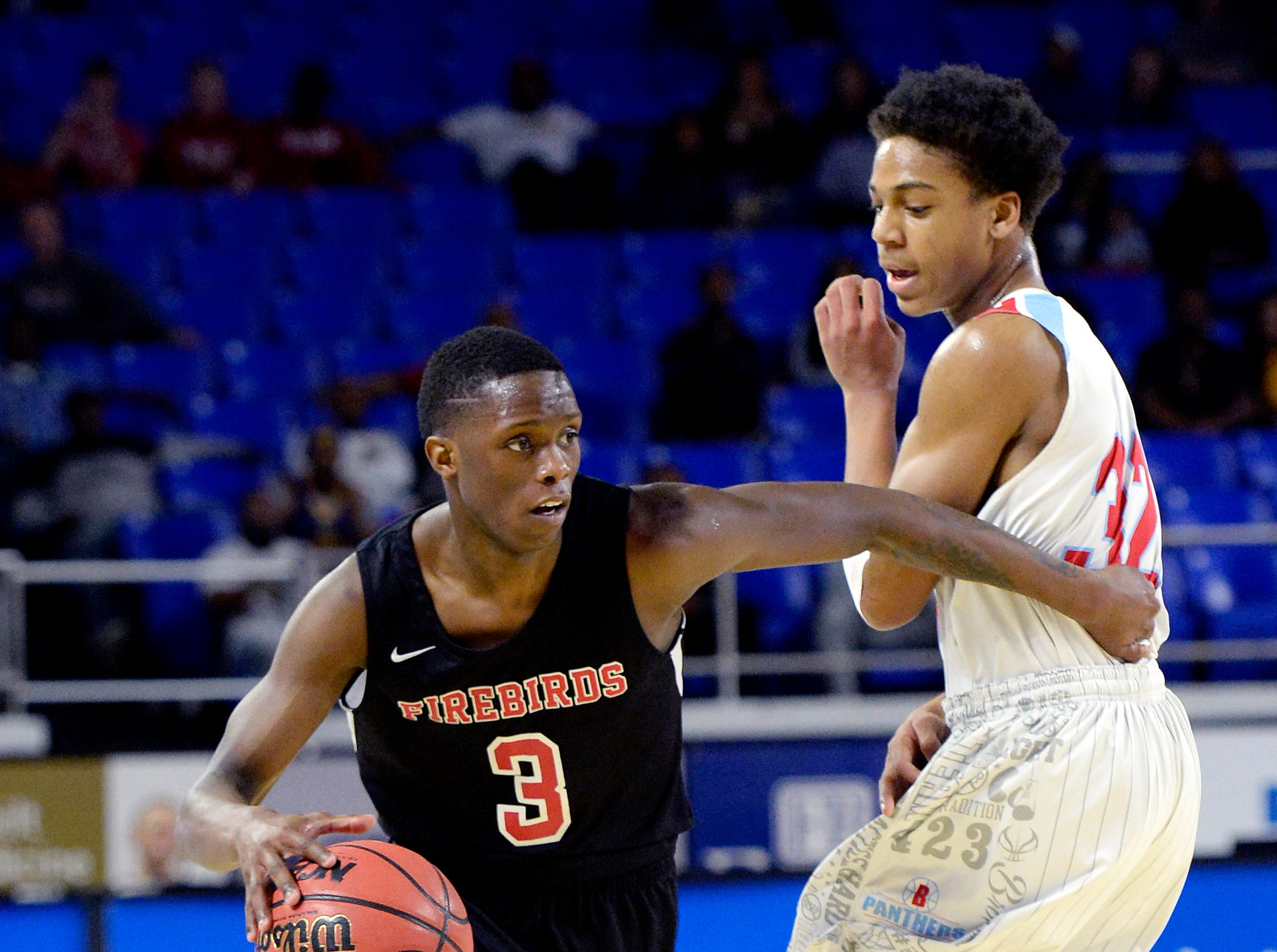 Pearl-Cohn guard William Shaw (3) drives past Brainerd forward Cameron Evans (32) during the first half of a Class AA boys state basketball quarterfinal game Wednesday, March 13, 2019, in Murfreesboro, Tenn.