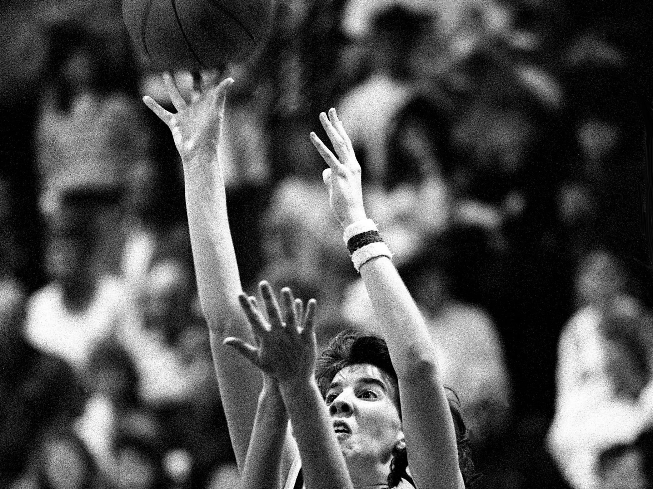 Goodpasture High's Becky Fitzgerald (51) gets off a shot despite the defense of Cheatham County High's Kim Chandler, left, and Angel Allen. Fitzgerald had a game-high 34 points, but Cheatham County won the TSSAA Region 6-AA championship game 64-63 in Goodpasture gym March 2, 1989.