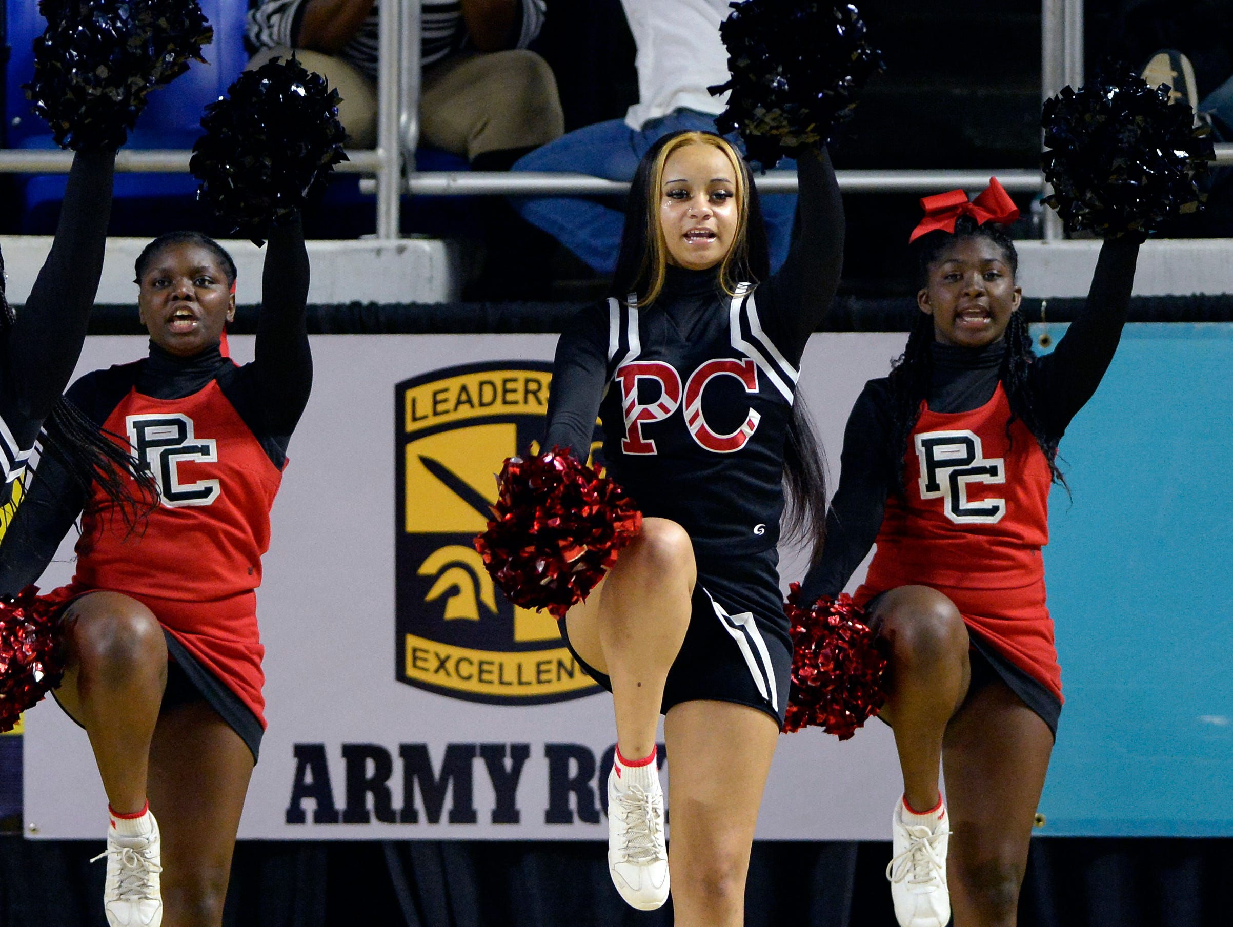 Pearl-Cohn cheerleaders perform during the first half of a Class AA boys state basketball quarterfinal game against Brainerd Wednesday, March 13, 2019, in Murfreesboro, Tenn.