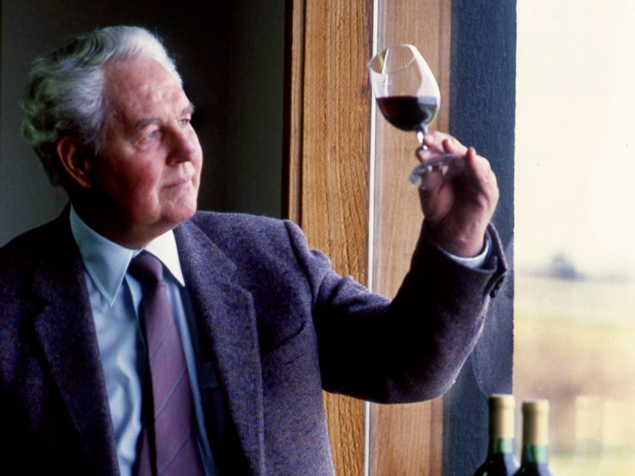 Judge William O. Beach, owner of the Beachhaven Vineyards and Winery in Clarksville, examines a glass of his cabernet sauvignon wine March 22, 1989. Beach, who served as both country judge and criminal judge of Montgomery County before his retirement in 1982, was a charter member of the Tennessee Viticultural and Oenological Society in 1973.