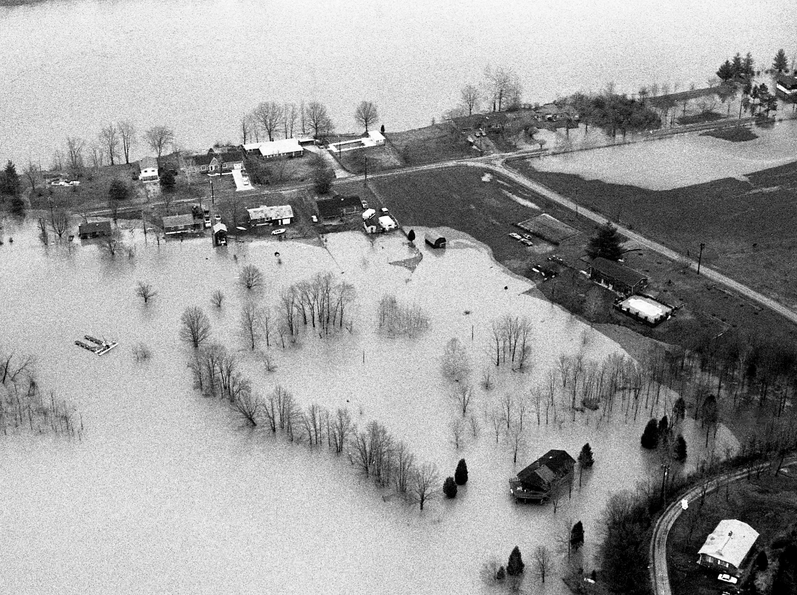 Floodwaters from the Cumberland River after a weekend of almost-constant rainfall turn neighborhoods along Highway 12 east of Ashland City into a lake March 6, 1989.