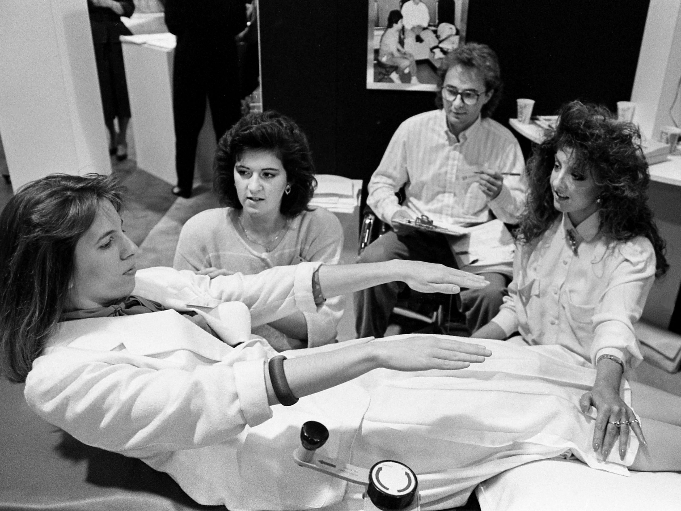 Nancy Griswold, left, undergoes the body composition, flexibility and strength test offered by West Side Hospital during the third annual Southern Women's Show at the Nashville Convention Center on March 17, 1989. Administering the test are physical therapist Kathryn Lindamood, second from left, and physical therapist assistant students Mike Curtis and Raney Jewell.