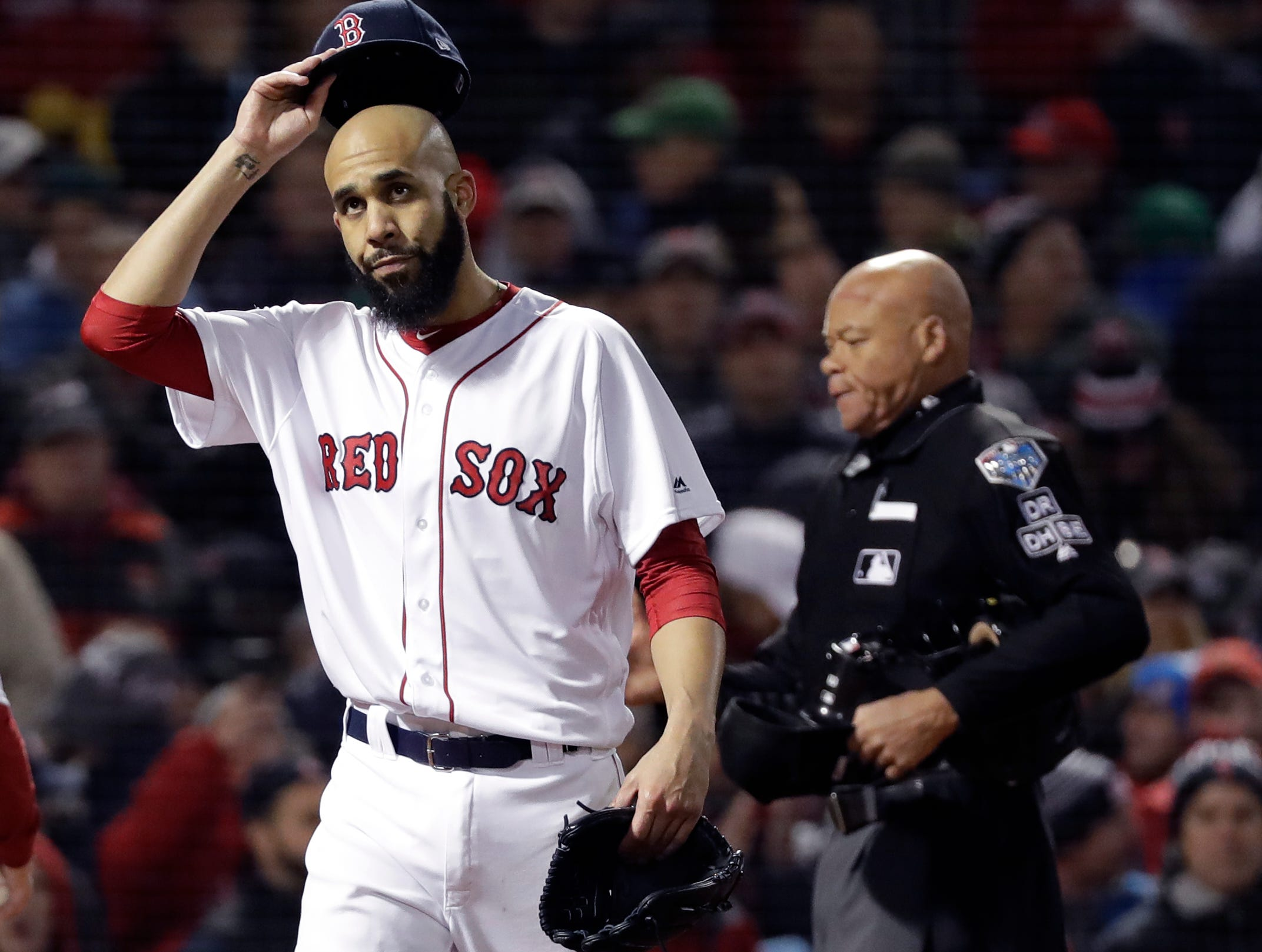 Boston Red Sox pitcher David Price walks off the infield after allowing two runs during the fourth inning of Game 2 of the World Series against the Los Angeles Dodgers Wednesday, Oct. 24, 2018, in Boston.