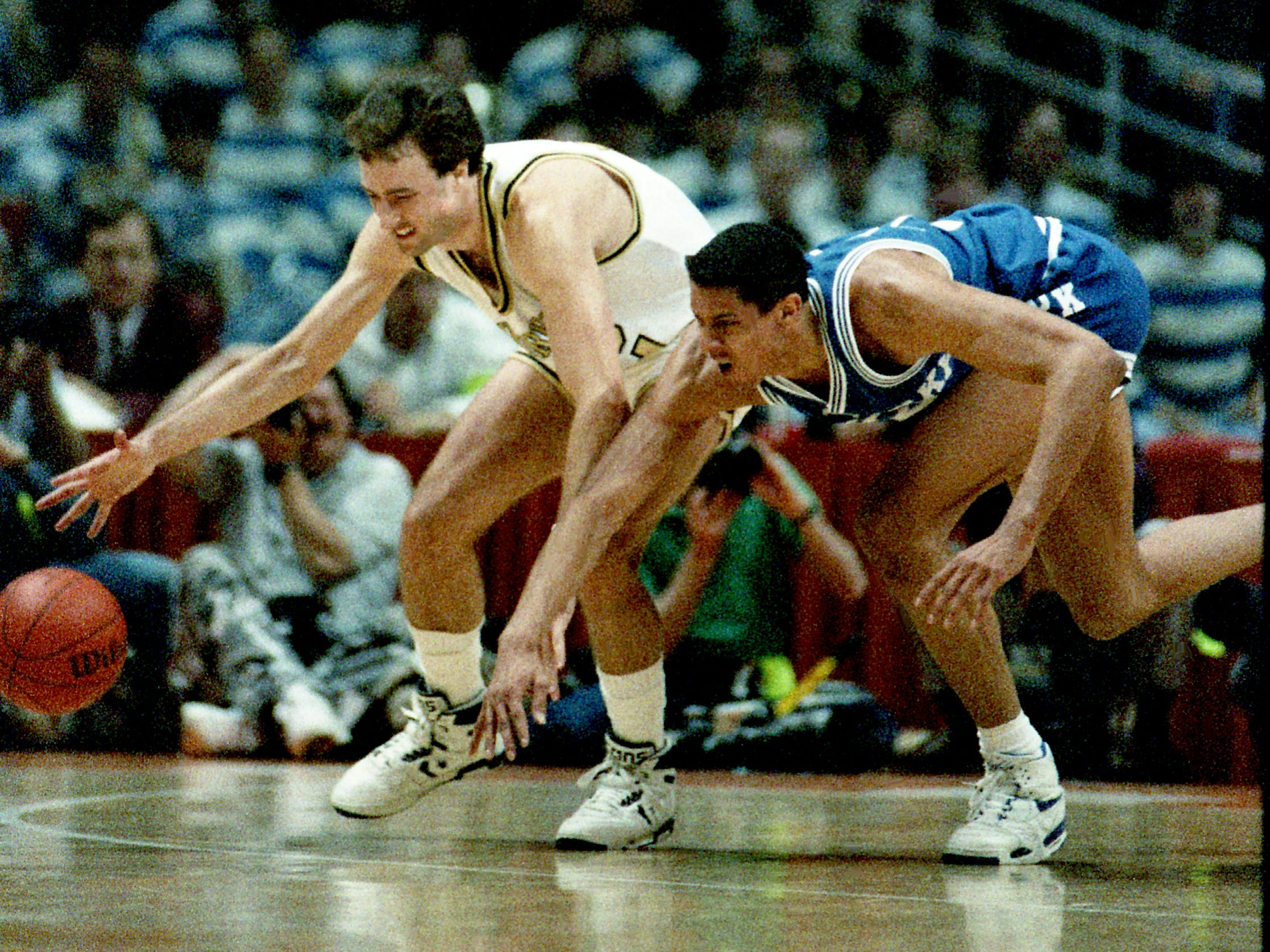 Vanderbilt's Barry Goheen, left, and Kentucky's LeRon Ellis are in step as they go after a loose ball as the Commodores defeated Kentucky 77-63 in the SEC Championship Tournament at Tennessee's Thompson-Boling on March 10, 1989. The win marked the school's first SEC tournament win in five years.