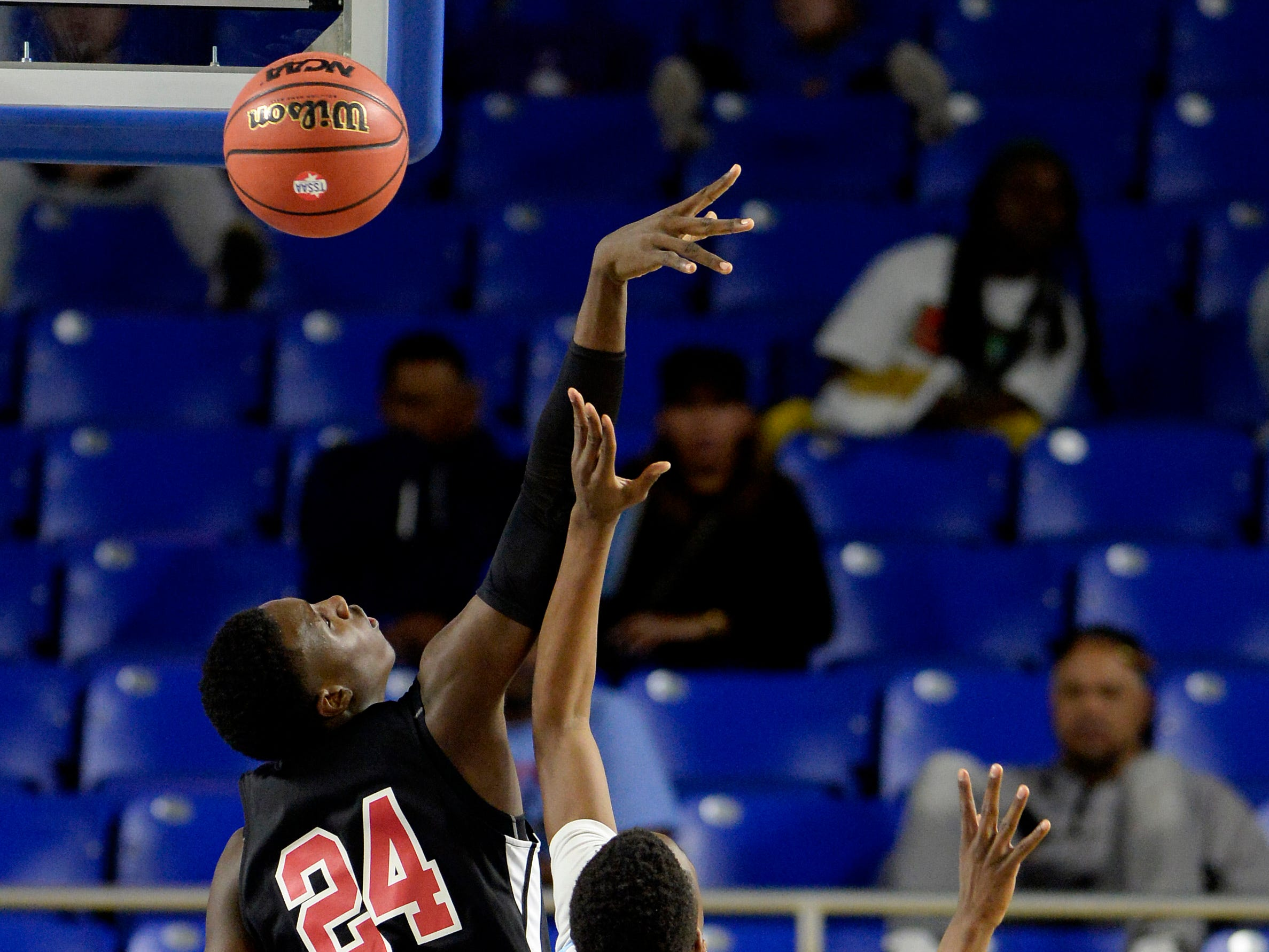 Pearl Cohn forward Tyrone Marshall (24) block a shot by Brainerd forward Laderron Freeman (4) during the first half of an Class AA boys' state basketball quarterfinal game Wednesday, March 13, 2019, in Murfreesboro, Tenn.