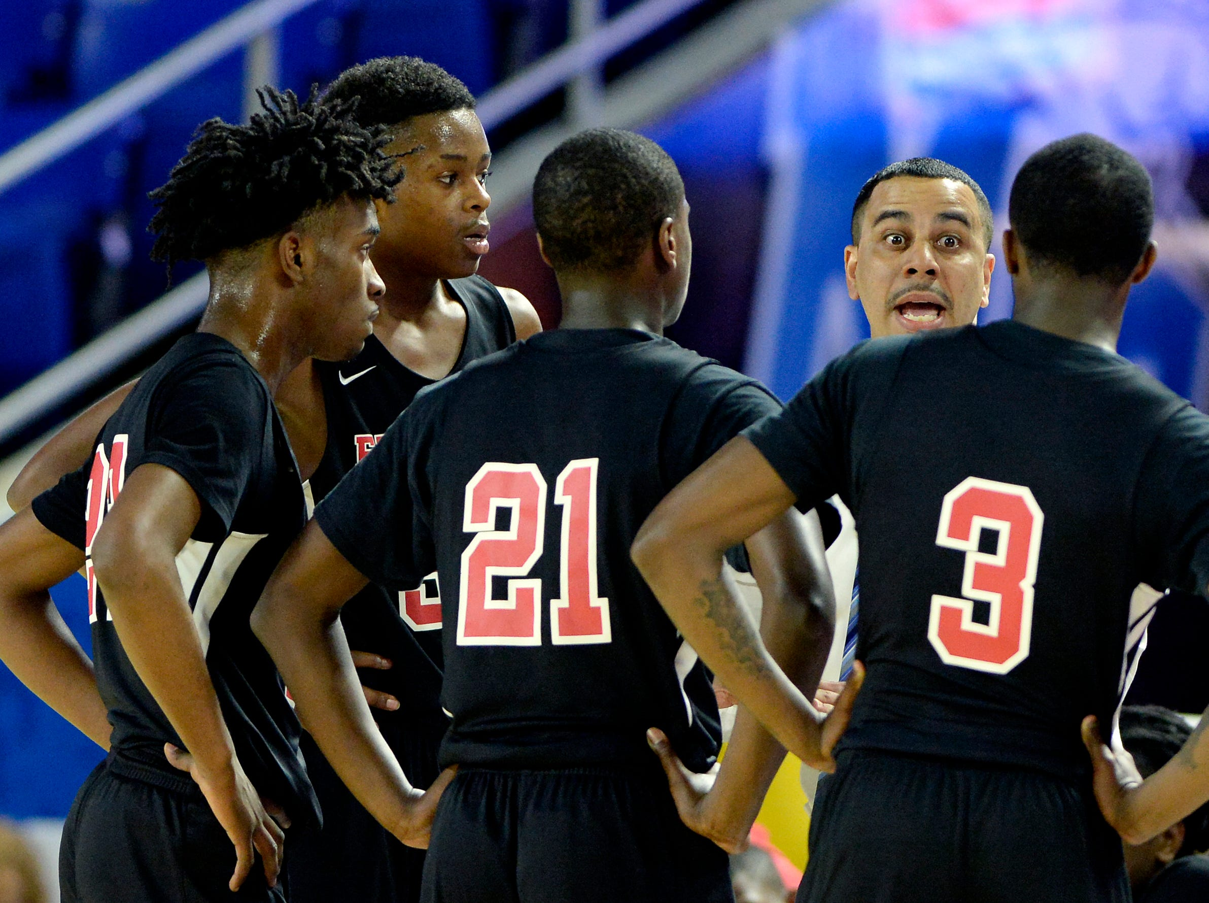 Pearl-Cohn head coach Terry Cole talks with his players during the first half of a Class AA boys state basketball quarterfinal game against Brainerd Wednesday, March 13, 2019, in Murfreesboro, Tenn.