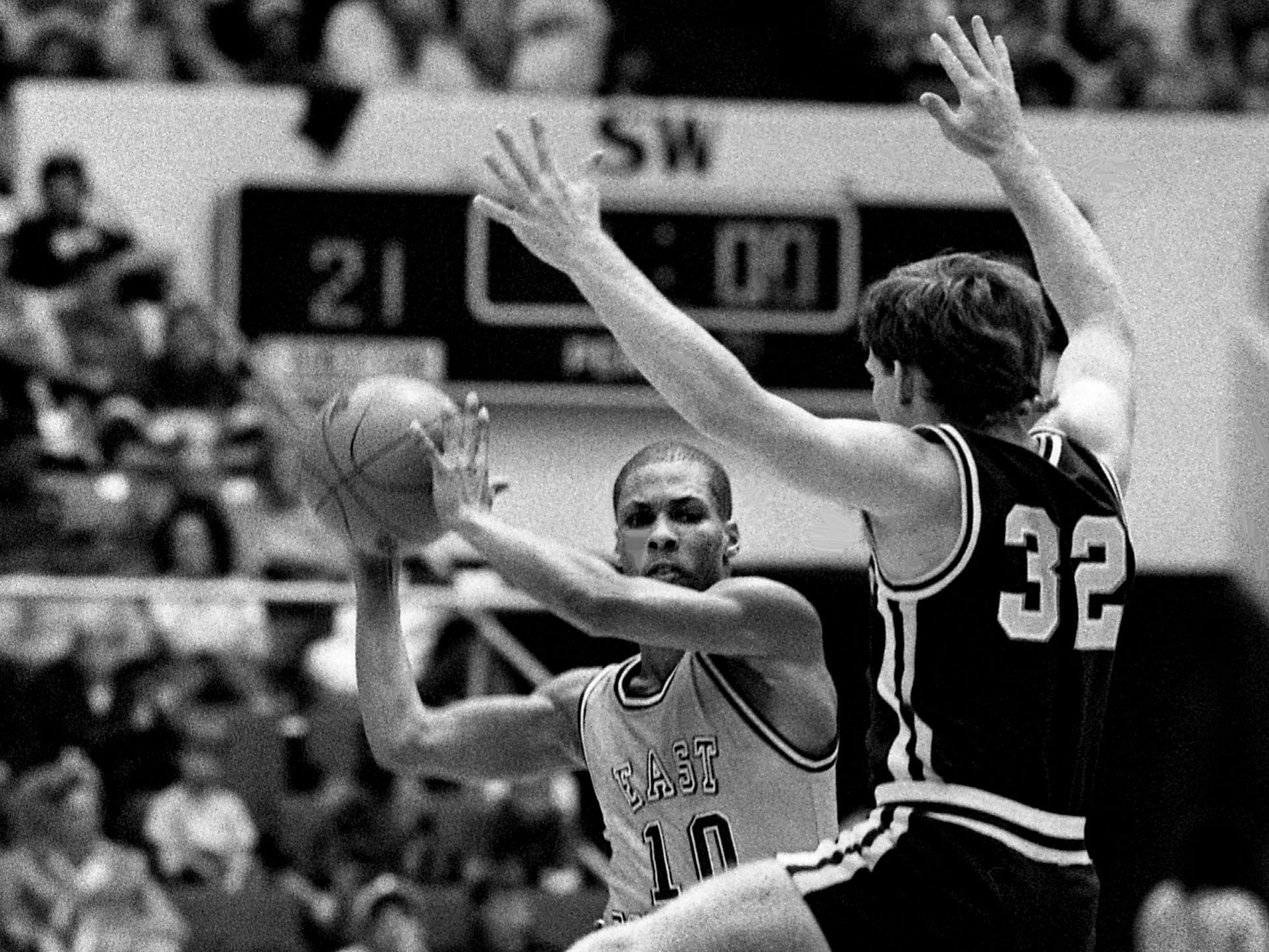 East Robertson High guard Tyrone Dotson (10) looks to pass around Keith Duggins of Oliver Springs High (32) during East Robertson's 83-62 TSSAA Class A state championship victory at MTSU's Murphy Center in Murfreesboro on March 18, 1989.