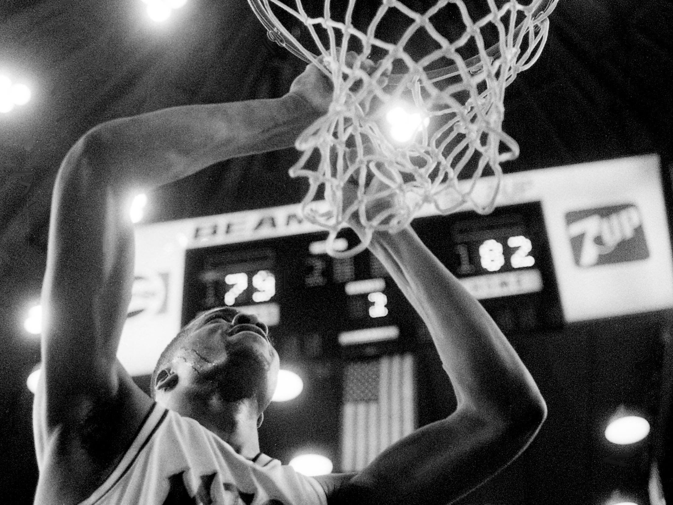 Middle Tennessee State's Chris Ingram takes his turn at snipping down the nets after their dramatic 82-79 come-from-behind victory over Austin Peay at Municipal Auditorium on March 9, 1989. MTSU improved their record to 22-7 and earned the league's automatic bid to the NCAA Tournament.