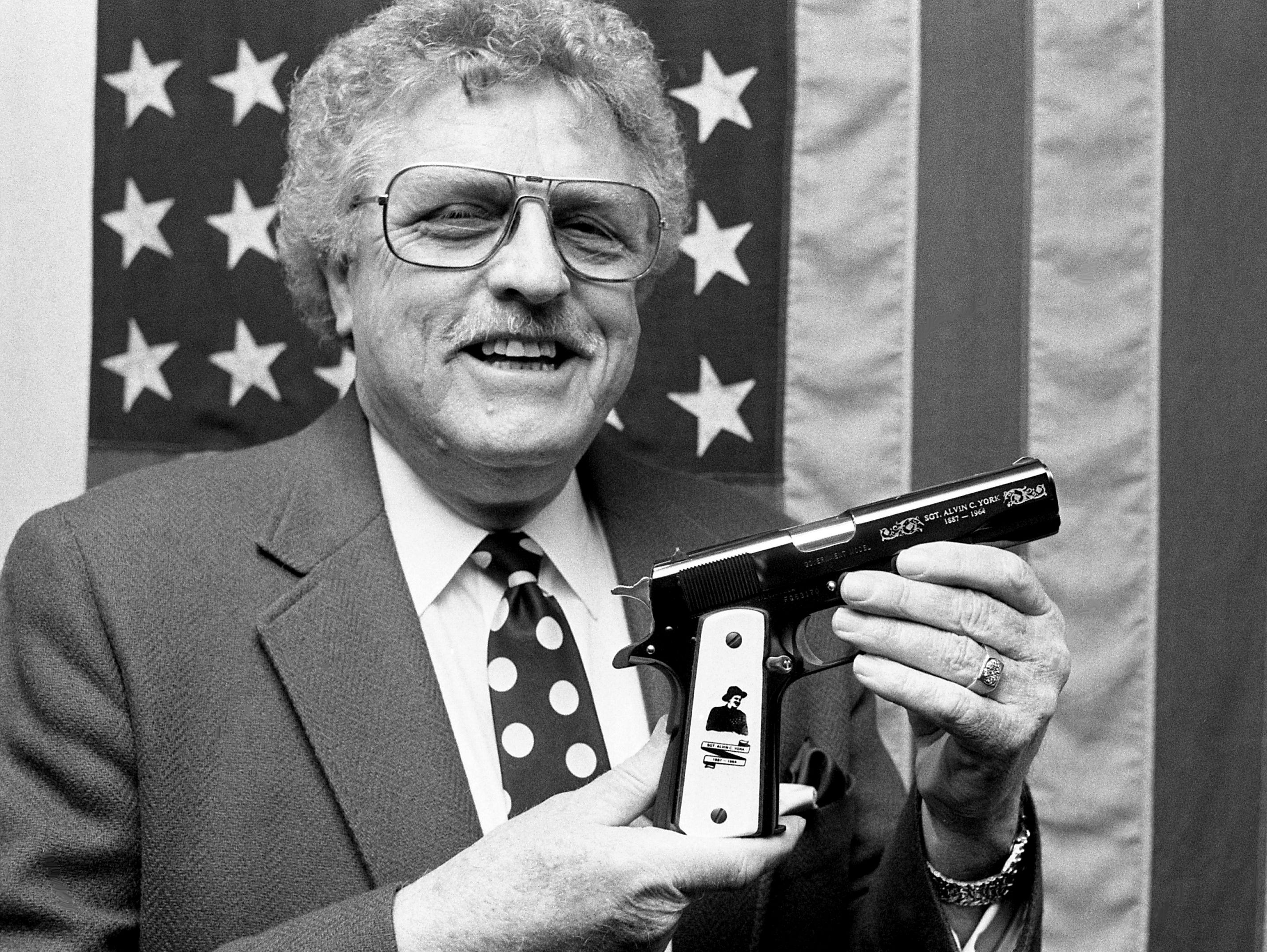 George York holds the Colt. 45 commemorating his father, World War I hero Sgt. Alvin C. York, in the Tennessee State Museum display at the War Memorial building on March 1, 1989. The pistol, one of 300, was located and given to the museum at the request of York.