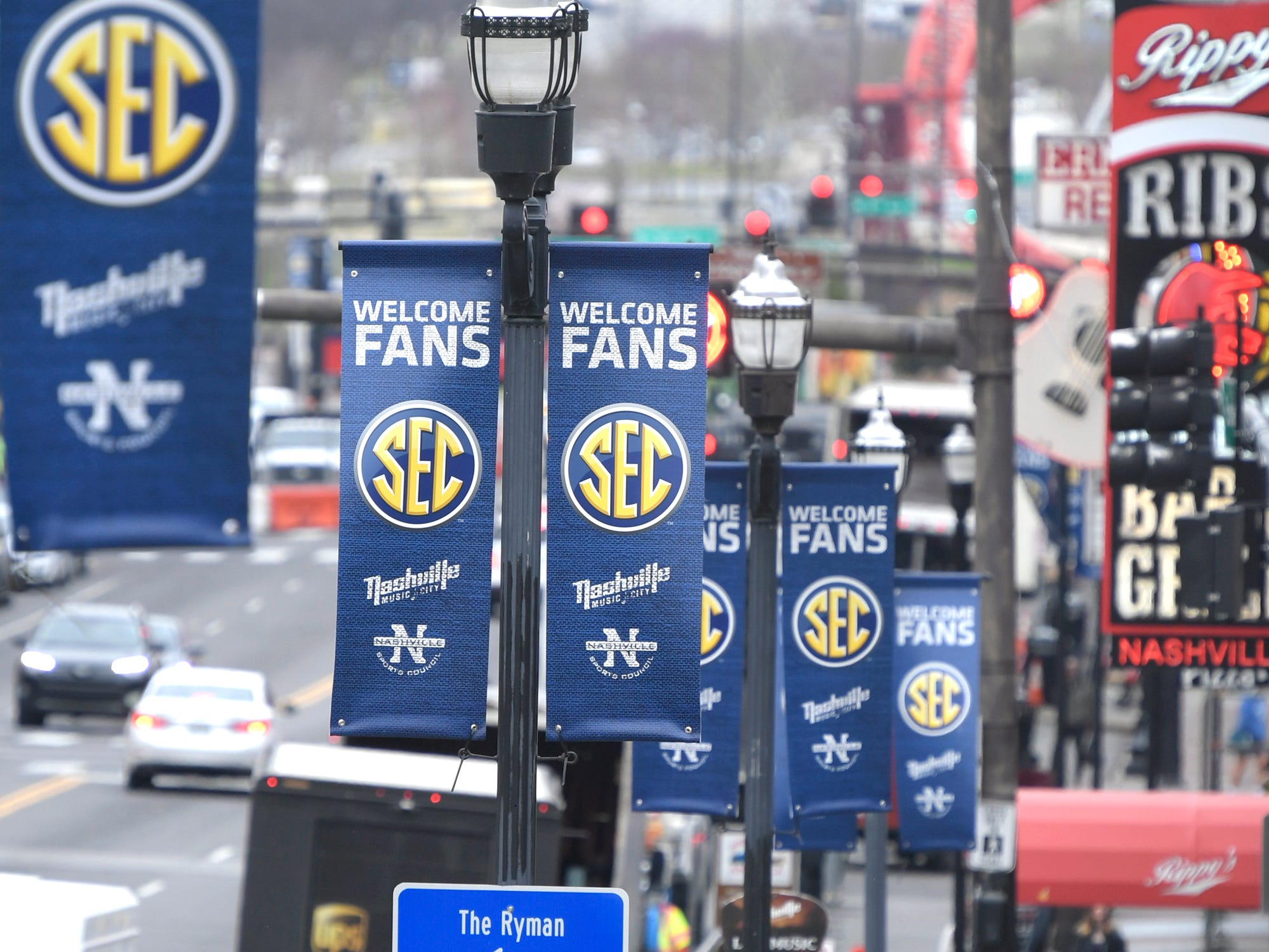 SEC Men's Basketball Tournament banners hang in downtown Nashville on Wednesday, March 13, 2019.