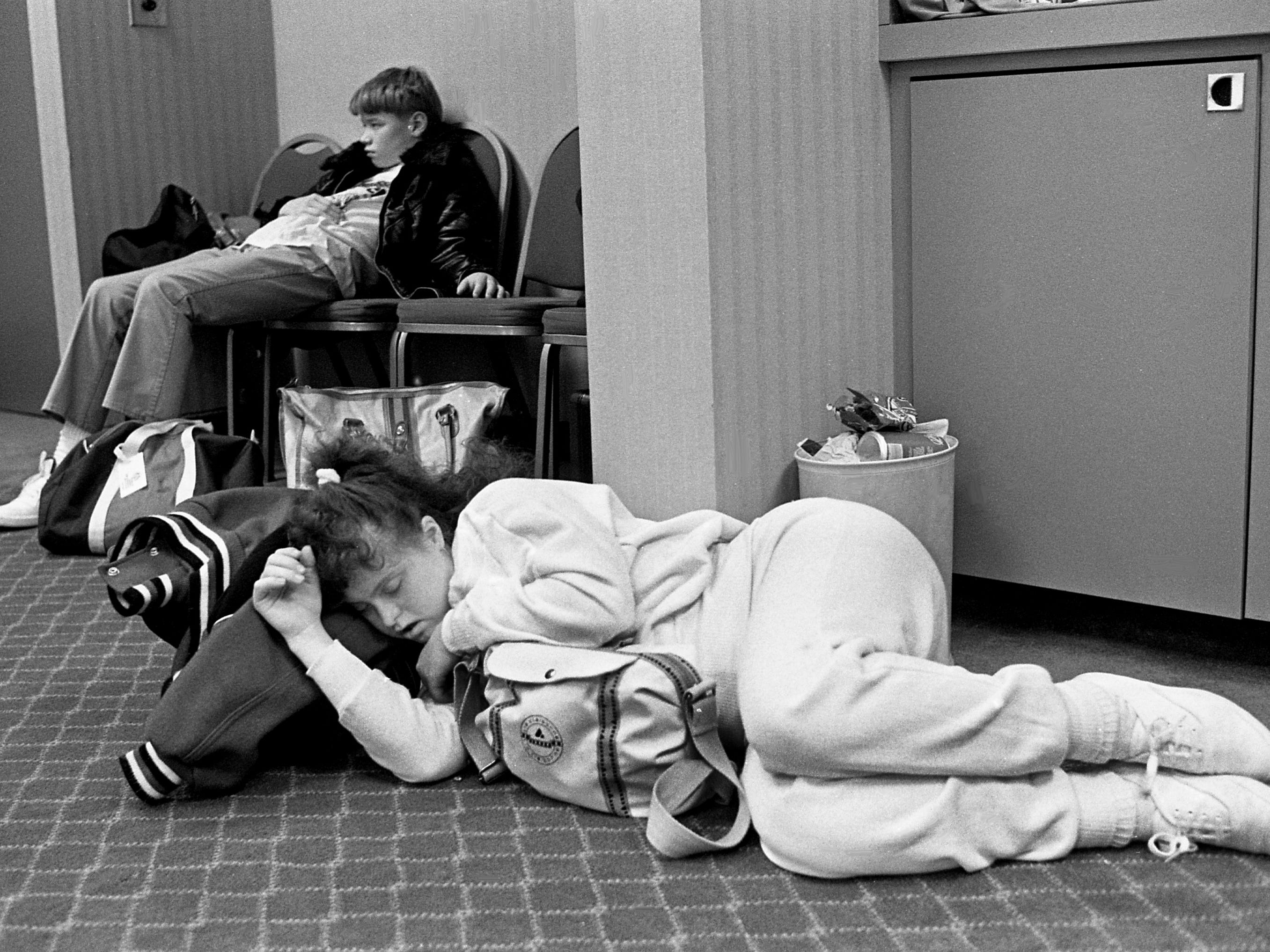 Figure skater Holly Blair, 18, foreground, and Michael Anderson, 12, both of Memphis, rest while waiting at Nashville Ramada Inn on March 31, 1989, for their ride to take them to the airport. They have a flight to Reno, Nevada, for the 1989 International Winter Special Olympics.