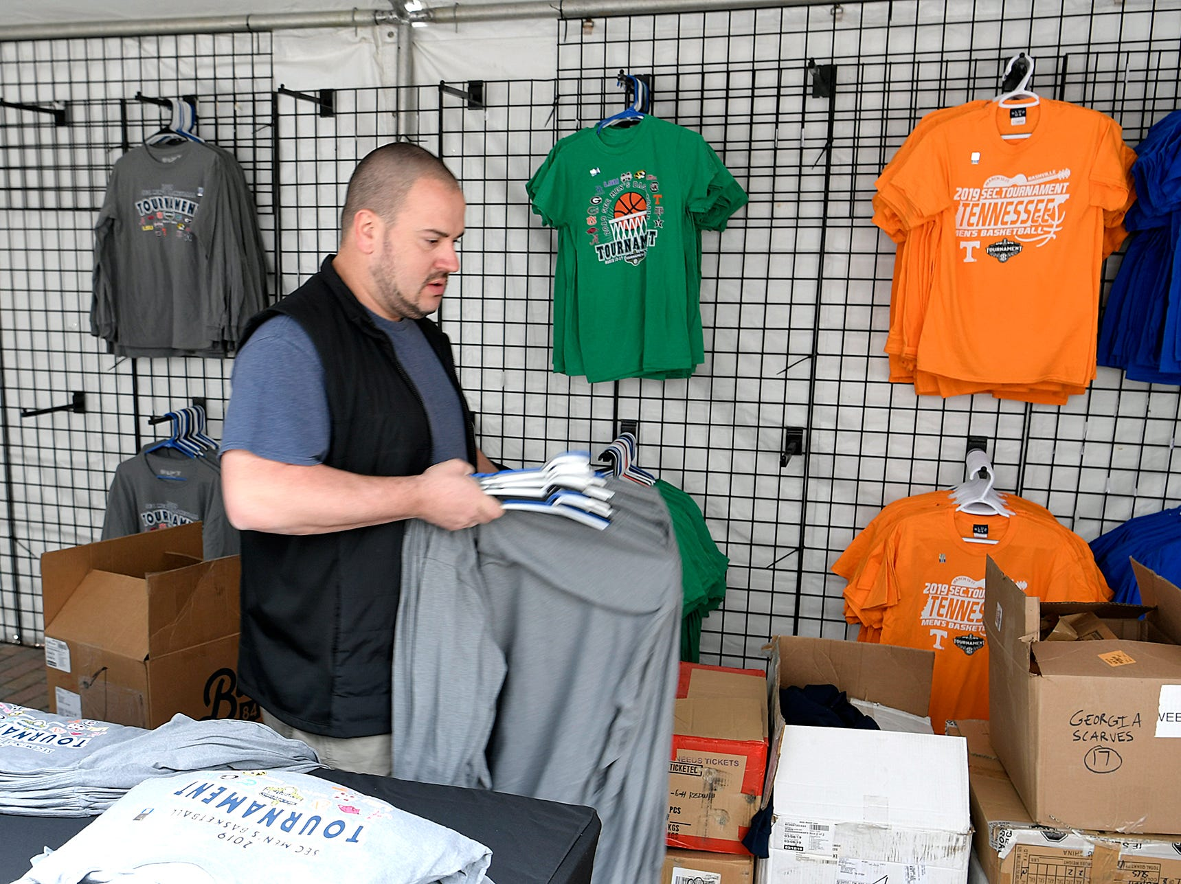 Lee Petty sets up a SEC Men's Basketball Tournament merchandise tent in downtown Nashville on Wednesday, March 13, 2019.