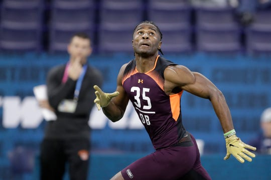 Vanderbilt defensive back Joejuan Williams runs a drill during the NFL football scouting combine, Monday, March 4, 2019, in Indianapolis.