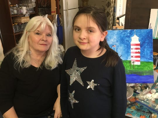 Charlotte Byrdfeather poses with student Anastasia Tamm at the Studio 76 Artists Group in White House.