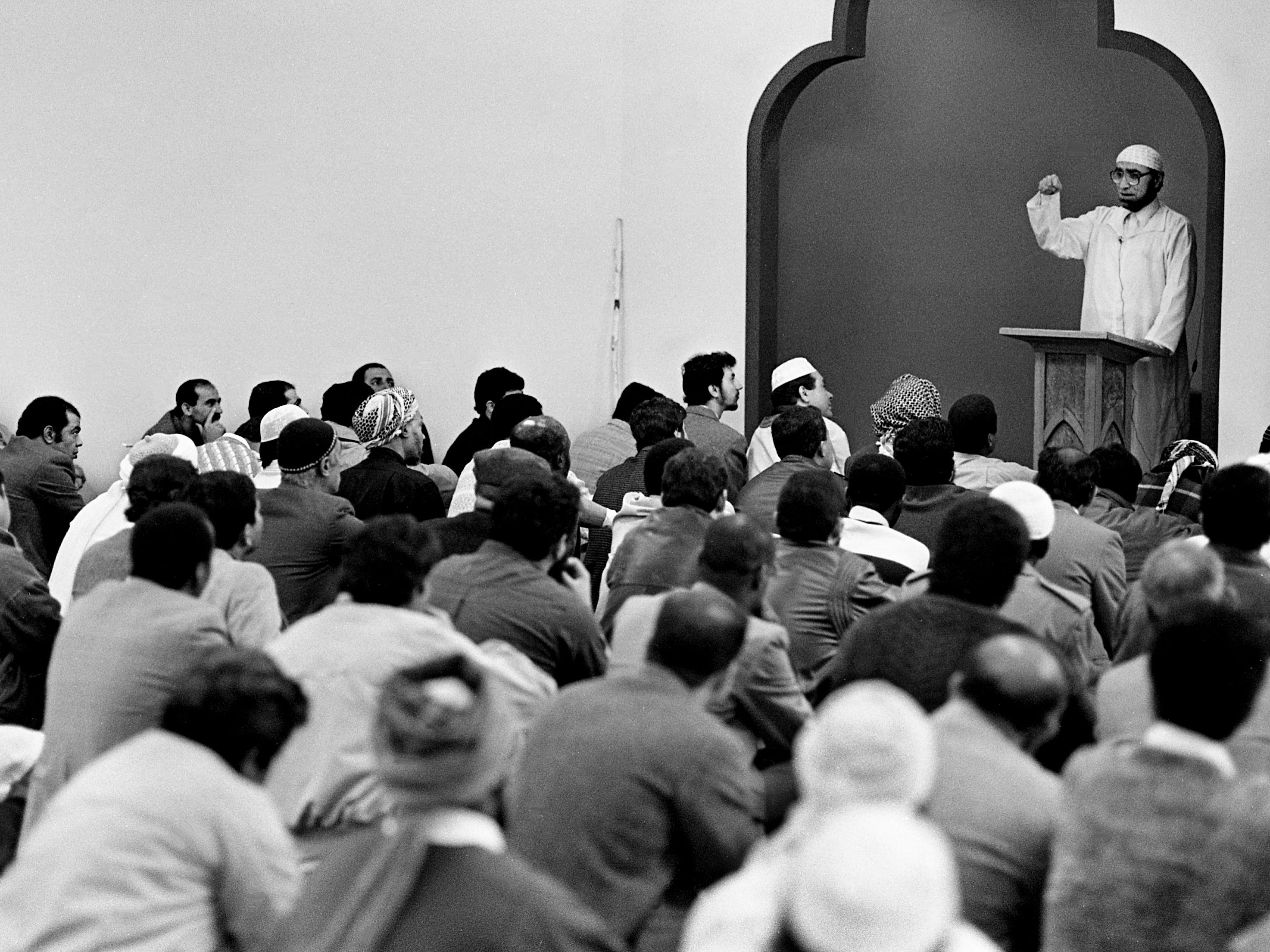 Nearly 300 local Muslims hear Islamic scholar Ahmad Sakr, a Muslim scholar from Chicago, during ceremonies to mark the opening of their new mosque, the Islamic Center, on 12th Ave. S., March 31, 1989.