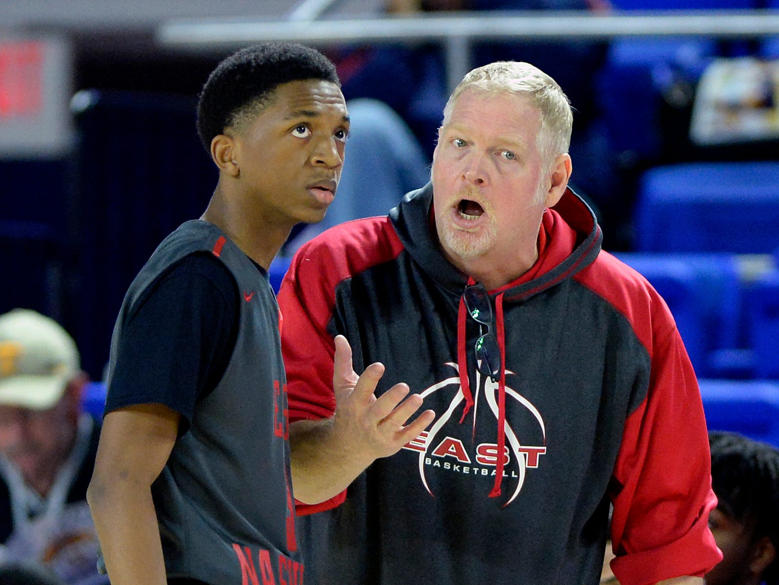 East Nashville head coach Jim Fey talks with Caleb Grimes during the first half of a Class AA boys' state basketball quarterfinal game against Howard Wednesday, March 13, 2019, in Murfreesboro, Tenn.
