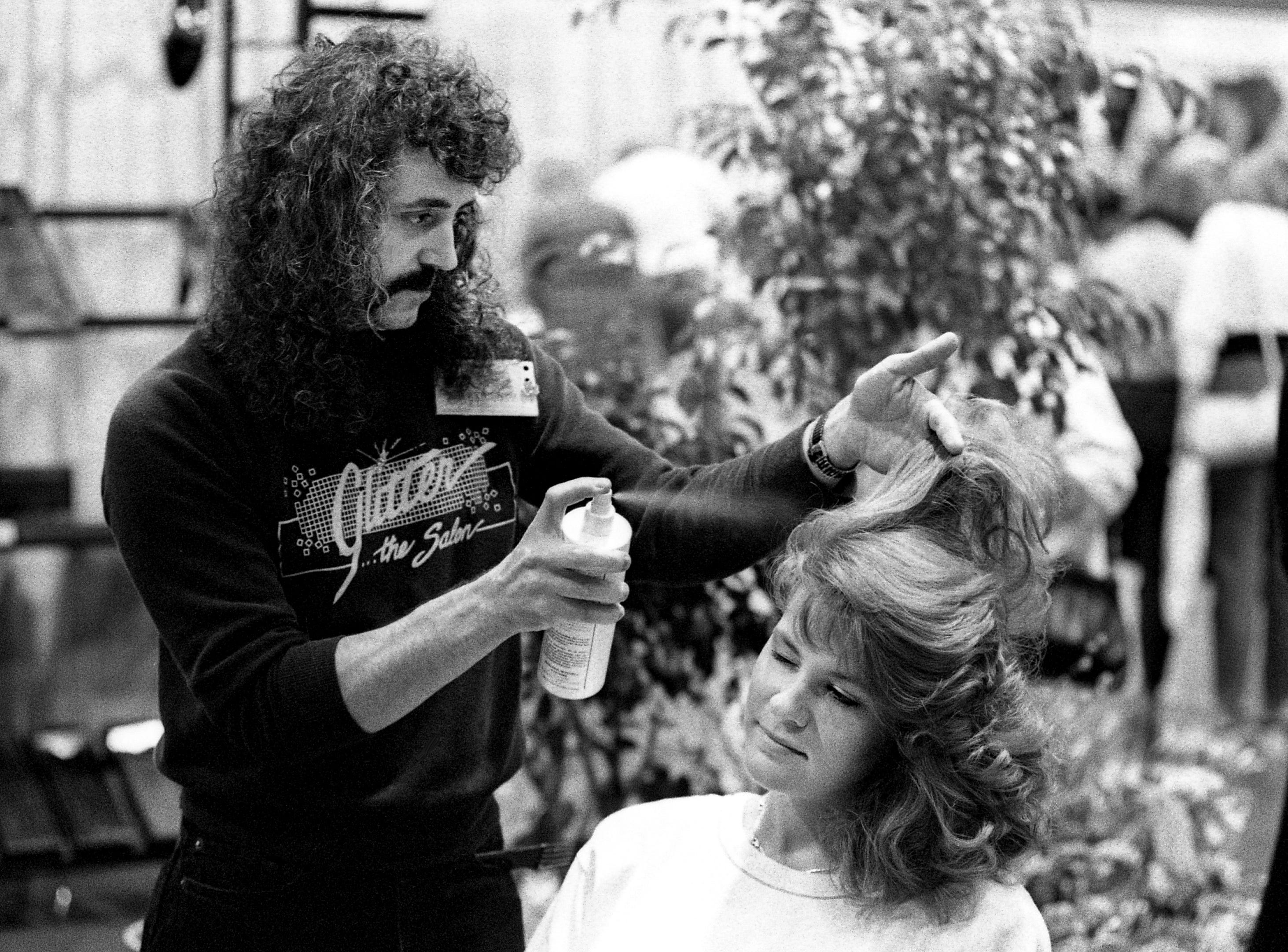 Mark Meeks of Glitter Salon styles Sonya Mansfield's hair during the third annual Southern Women's Show at the Nashville Convention Center on March 17, 1989.