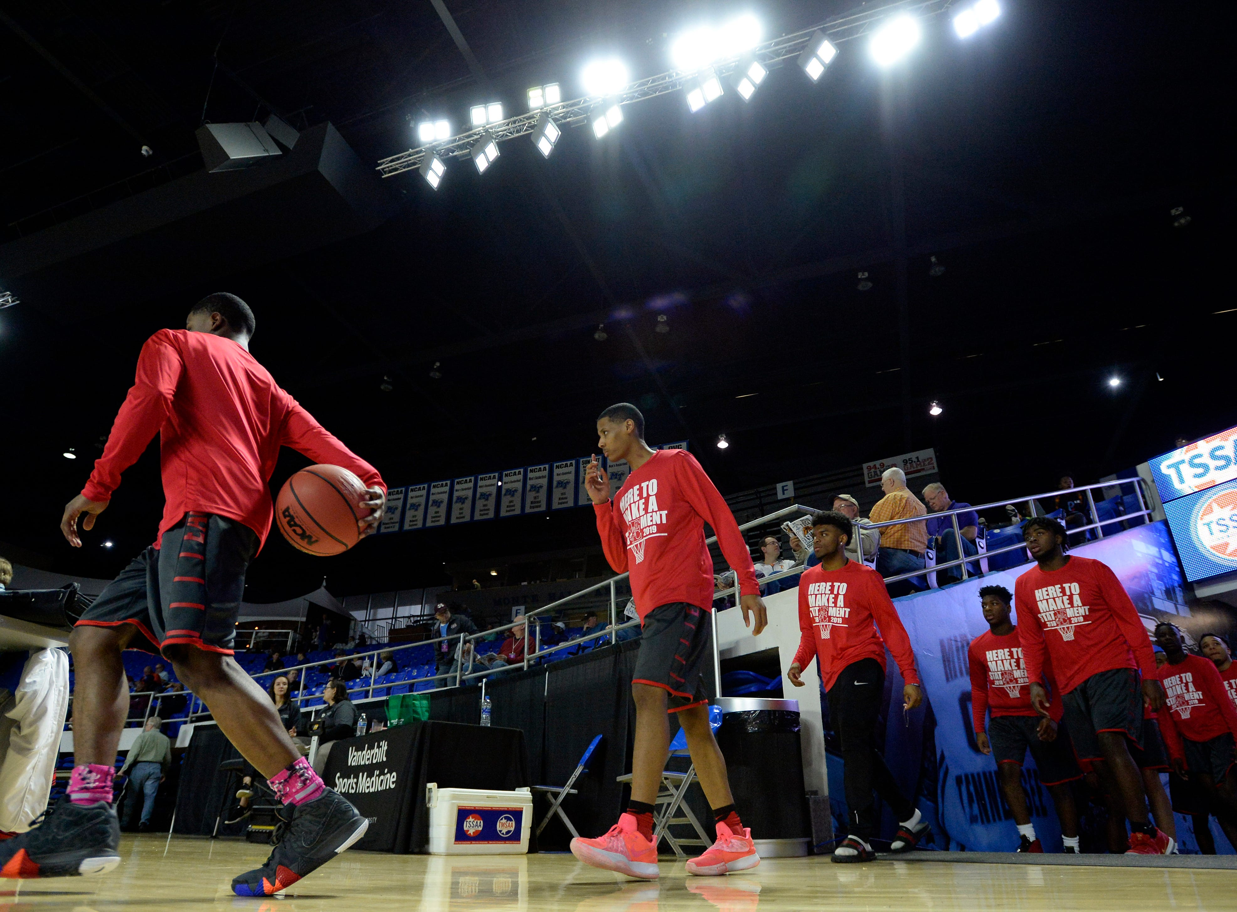 East Nashville players walk onto the court to warm up before playing Howard in a Class AA boys' state basketball quarterfinal game Wednesday, March 13, 2019, in Murfreesboro, Tenn.
