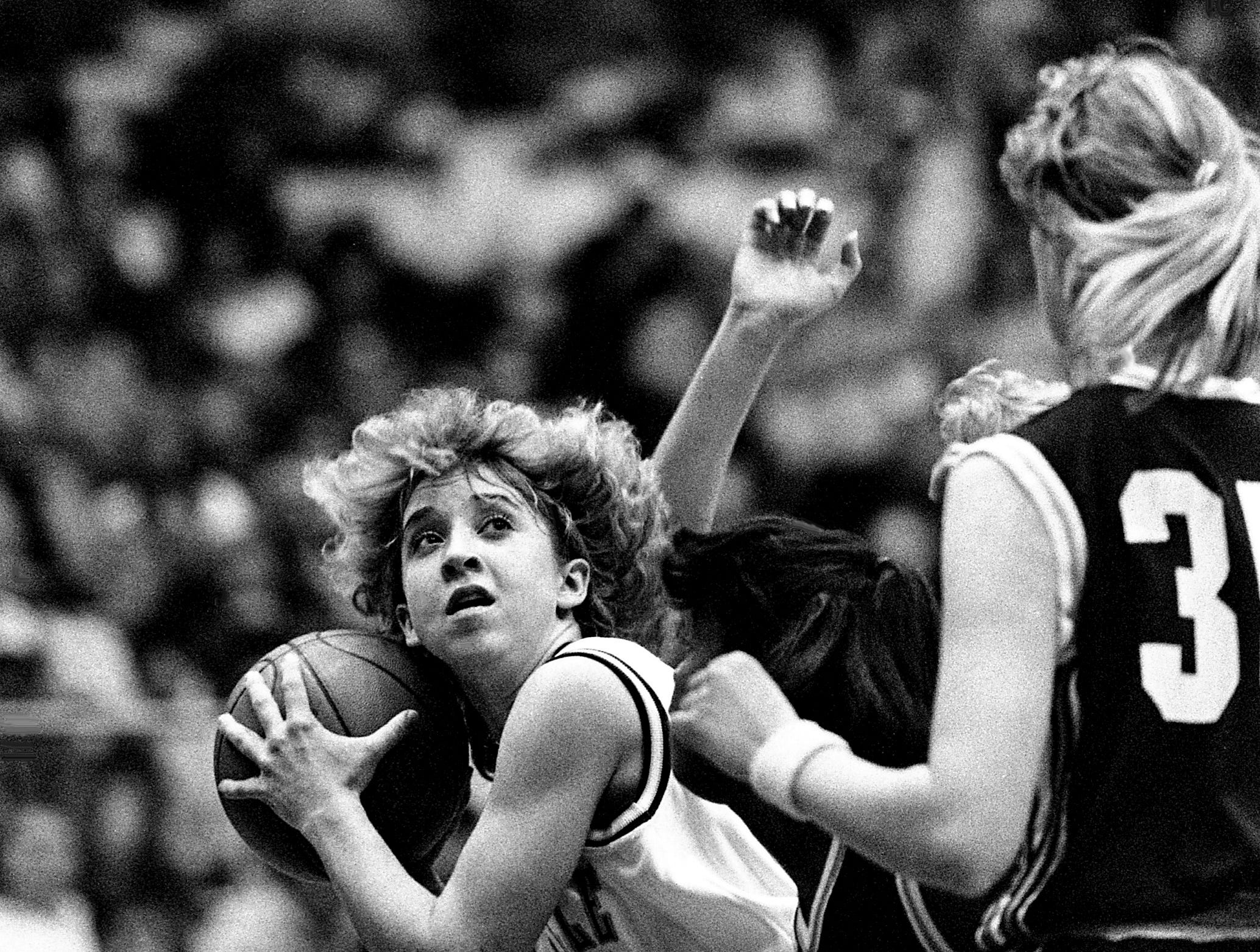 Shelbyville High's Sherry Batten, left, looks for a shot after grabbing an  offensive rebound during their 77-51 victory over Collierville High during the TSSAA Class AAA State tournament at MTSU's Murphy Center in Murfreesboro on March 9, 1989.