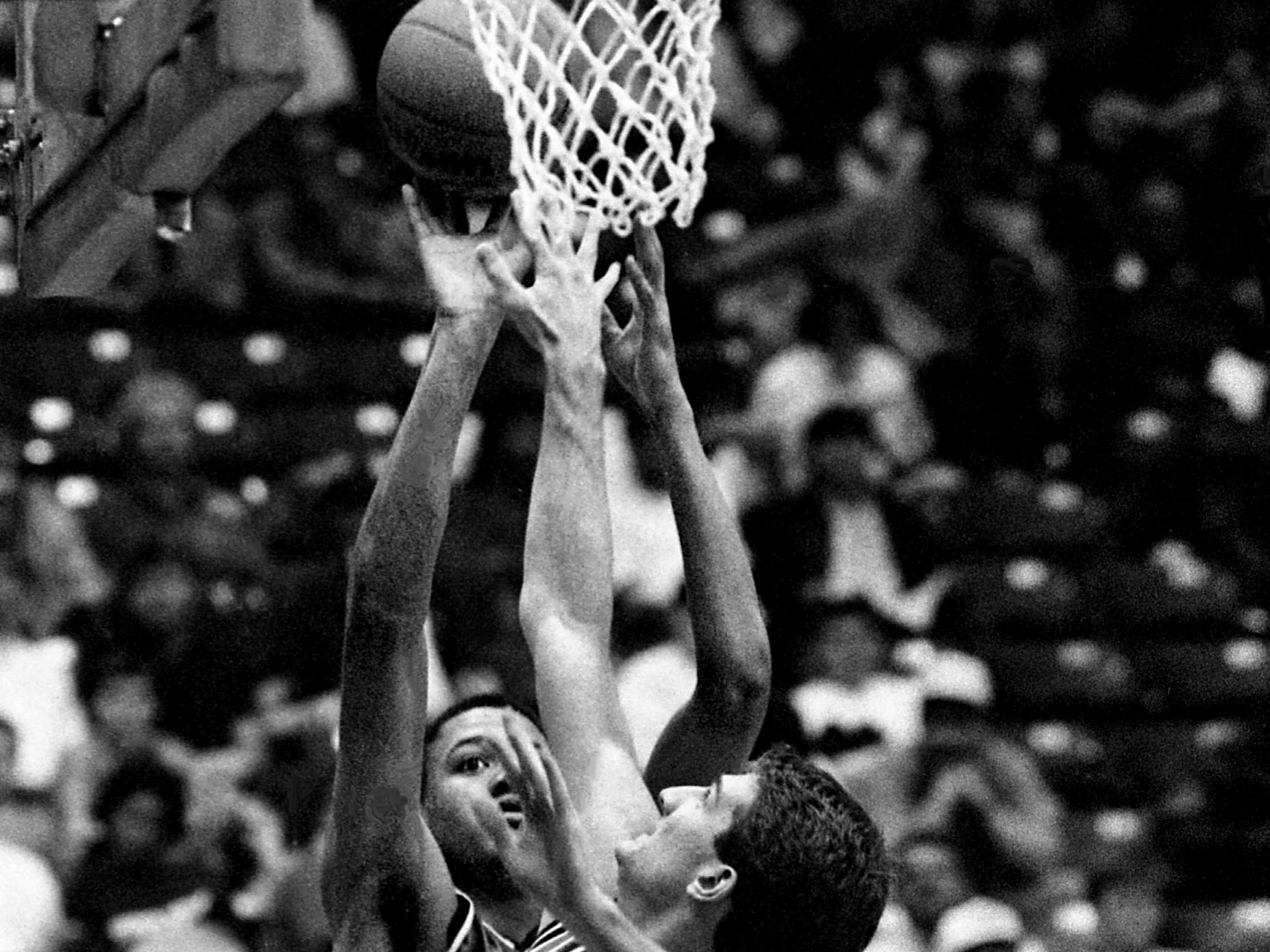 Whites Creek High's Corey Allen attempts to shoot despite the defense pressure from Franklin High guard Kevin Anglin. Allen scored 13 points for Whites Creek, but Anglin scored 25 for Franklin to win the TSSAA Class AAA title 43-42 at MTSU's Murphy Center in Murfreesboro on March 18, 1989.