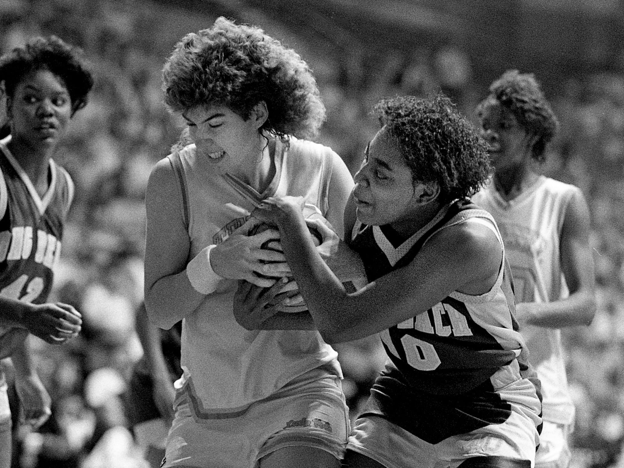 Tennessee senior Shelia Frost, left, wrestles with Long Beach State's Angeliaue Lee for the ball. The Lady Vols went on to a 94-80 victory in the NCAA East Regional championship game at Western Kentucky's Diddle Arena in Bowling Green, Kentucky, March 25, 1989.