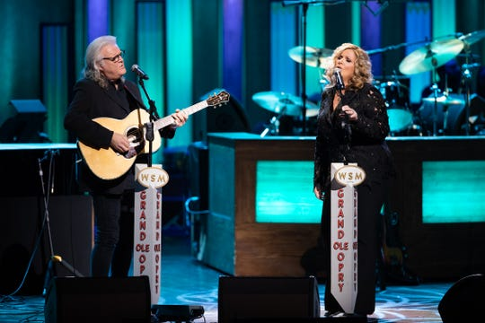 Trisha Yearwood and Ricky Skaggs perform during her 20th anniversary celebration at the Grand Ole Opry.