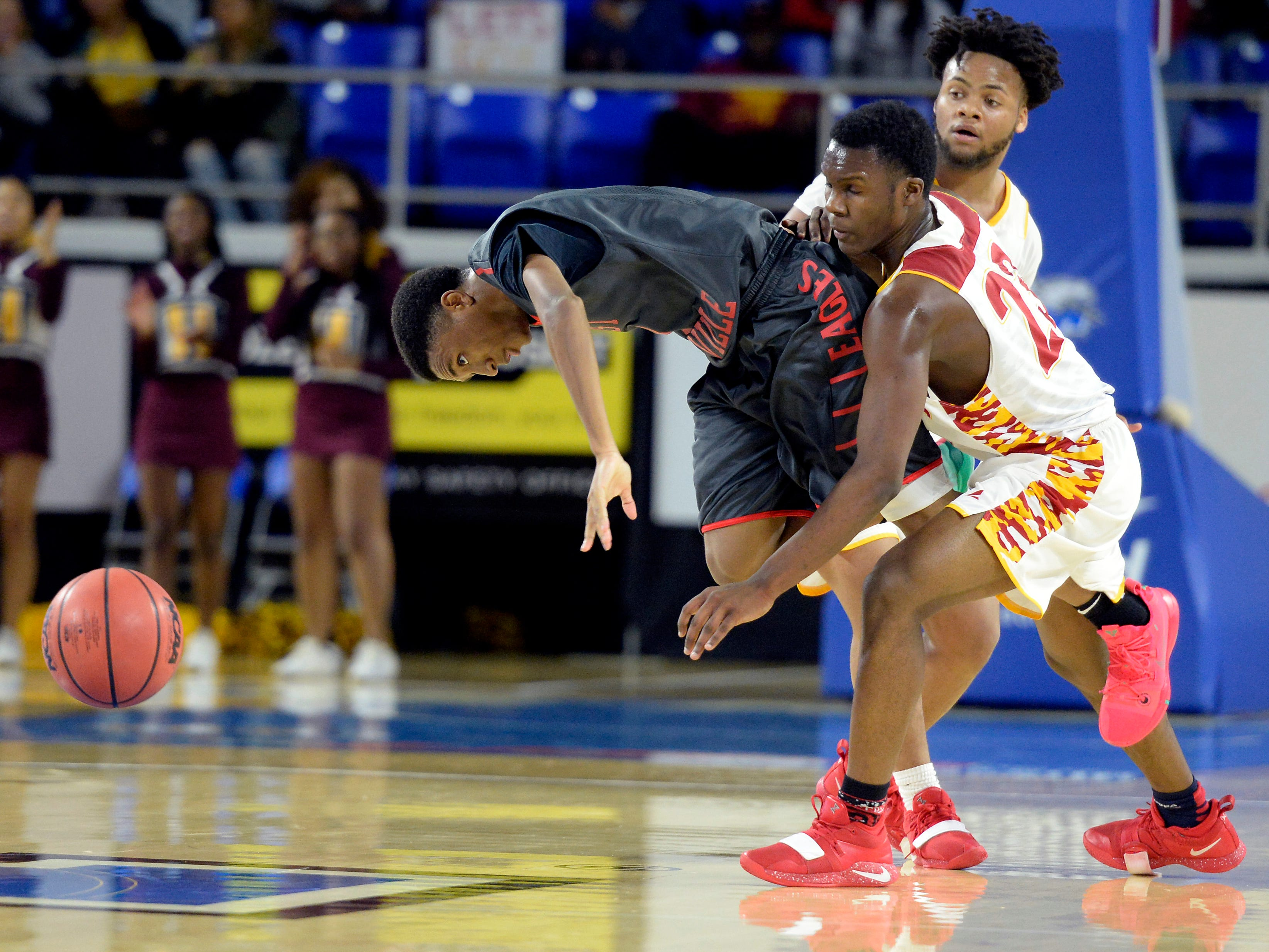 East Nashville guard Caleb Grimes, left, is fouled by Howard guard Calvin James (23) during the second half of an Class AA boys' state basketball quarterfinal game Wednesday, March 13, 2019, in Murfreesboro, Tenn. East Nashville won 78-75.