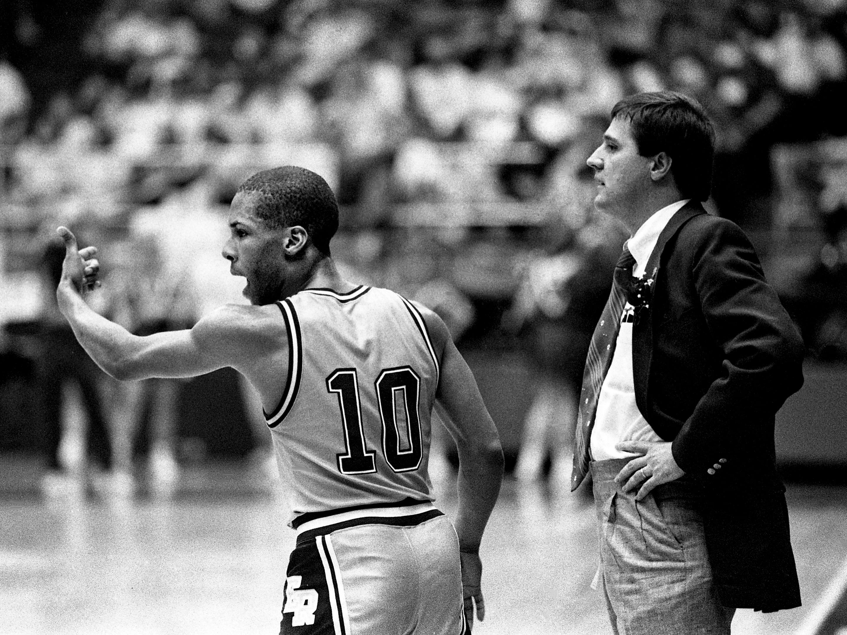 East Robertson High guard Tyrone Dotson (10) yells at his teammates as head coach David Collie looks on in their bid to win three consecutive TSSAA Class A titles. They are playing Oliver Springs High in the championship game at MTSU's Murphy Center in Murfreesboro March 18, 1989.