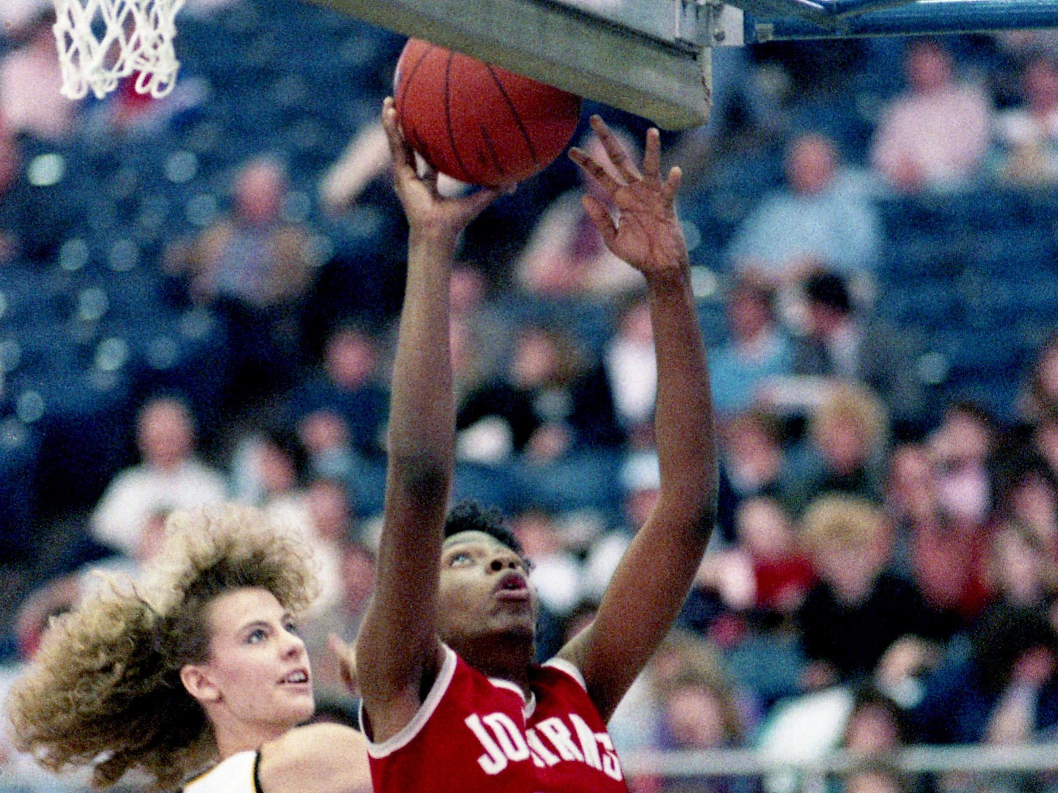 April Gardner (20) of Jo Byrns High pulls down a rebound in front of Annette Aaron of Pickett County High. Gardner pulled down 11 rebounds, but it was enough as Pickett County won 62-60 in the opening game of the TSSAA Class A State tournament at MTSU's Murphy Center on March 8, 1989.