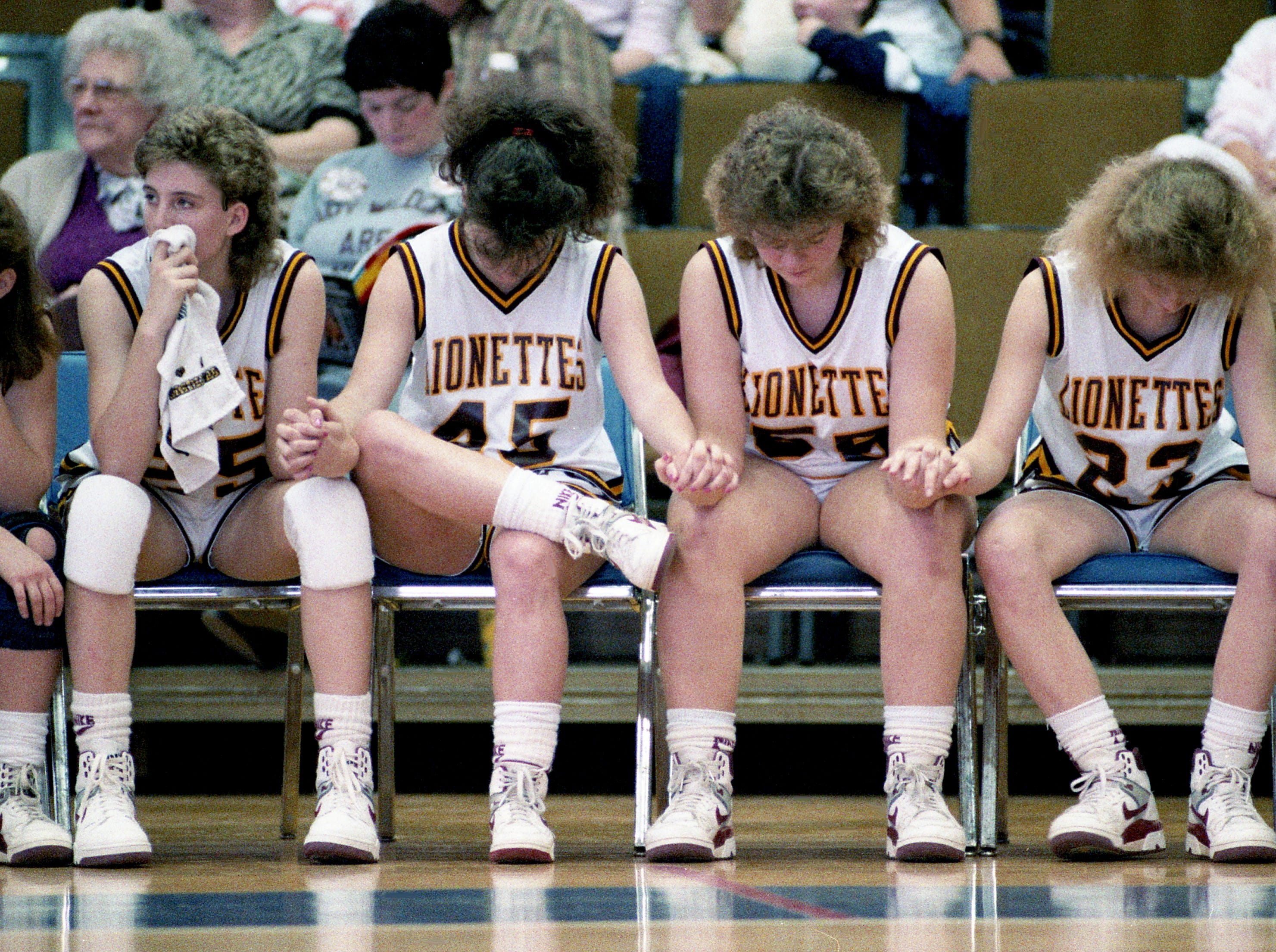 The Cannon County High bench offers silent support as they faced two-time defending champions South Greene High in overtime during the first round of the TSSAA Class AA State tournament at MTSU's Murphy Center in Murfreesboro on March 9, 1989. The players are Laveta Bassinger, left, Susan Wood, Charlotte Barks and Angie Sissom.
