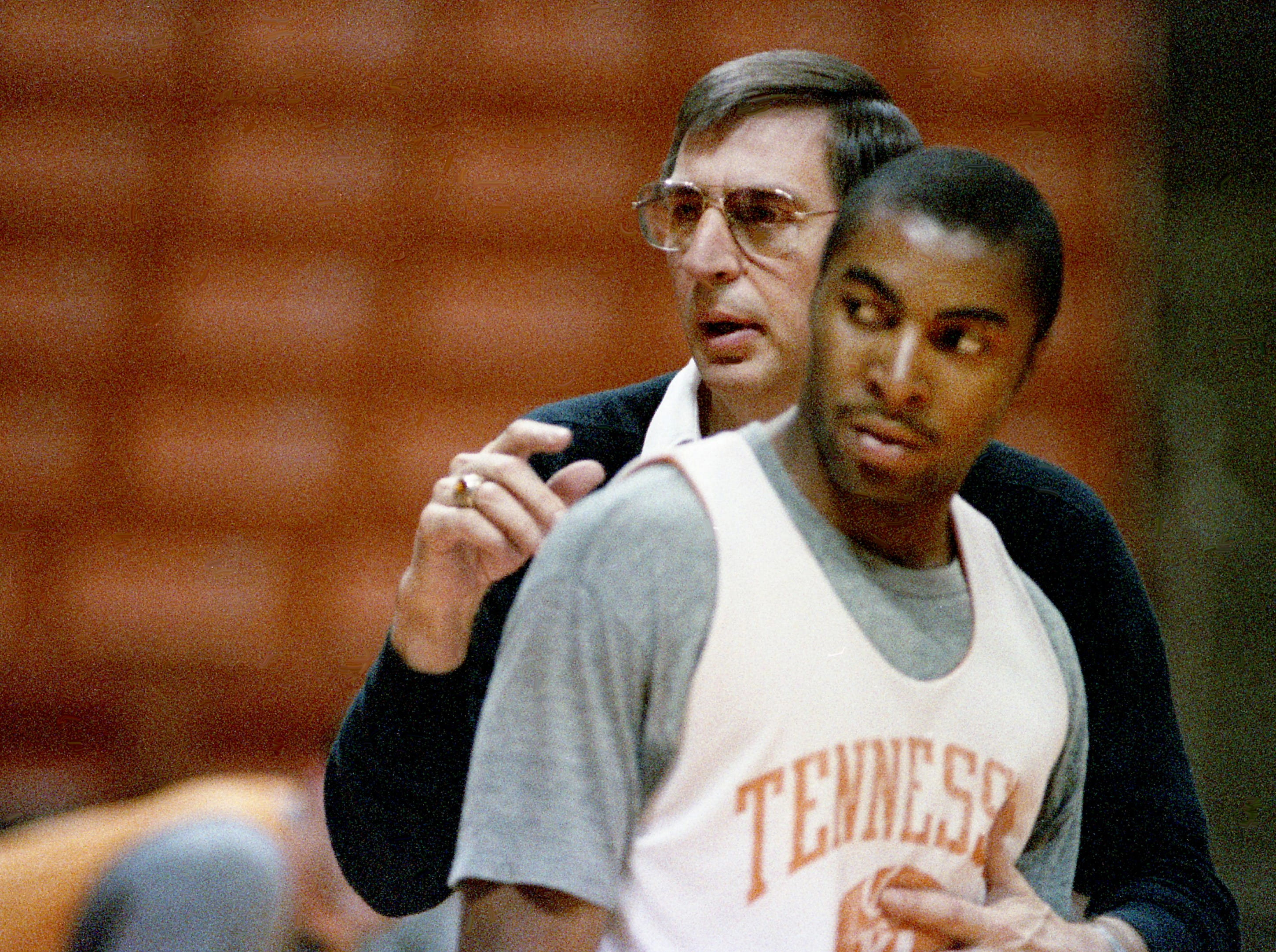 Tennessee head coach Don DeVoe positions junior guard Ron Taylor during practice on their own floor of Thompson-Boling Arena in Knoxville on March 9, 1989, for their showdown against LSU the next day in the SEC Tournament.
