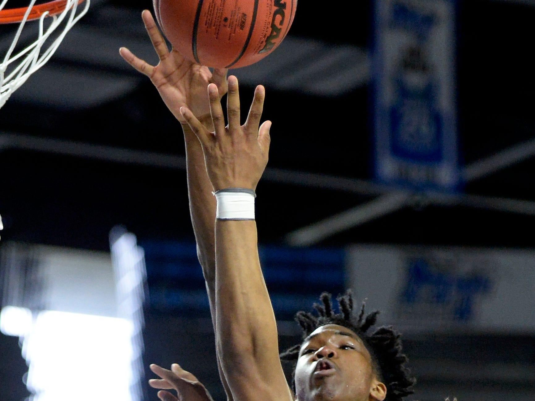 East Nashville guard Taras Carter (0) shoots against Howard forward Kerrick Thorne (14) during the second half of an Class AA boys' state basketball quarterfinal game Wednesday, March 13, 2019, in Murfreesboro, Tenn. East Nashville won 78-75.